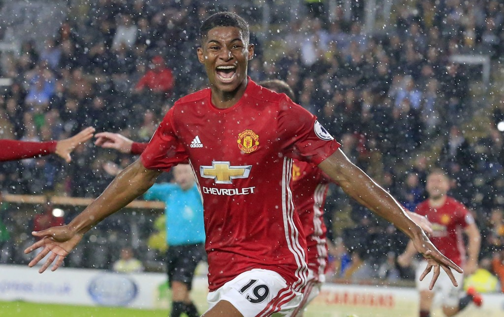 Manchester United's English striker Marcus Rashford celebrates after scoring their late winning goal during the English Premier League football match between Hull City and Manchester United at the KCOM Stadium in Kingston upon Hull, north east England on August 27, 2016. Manchester united won the game 1-0. / AFP / Lindsey PARNABY