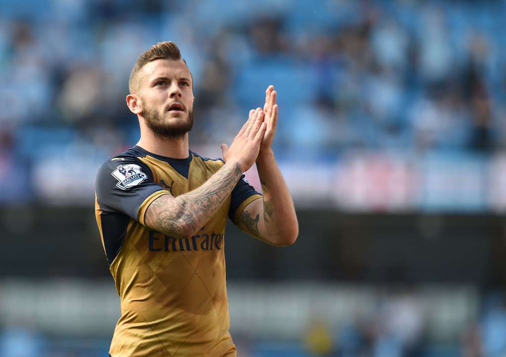 Arsenal's English midfielder Jack Wilshere applauds fans after the English Premier League football match between Manchester City and Arsenal at the Etihad Stadium in Manchester, north west England, on May 8, 2016. / AFP / PAUL ELLIS / RESTRICTED TO EDITORIAL USE. No use with unauthorized audio, video, data, fixture lists, club/league logos or 'live' services. Online in-match use limited to 75 images, no video emulation. No use in betting, games or single club/league/player publications. / (Photo credit should read PAUL ELLIS/AFP/Getty Images)