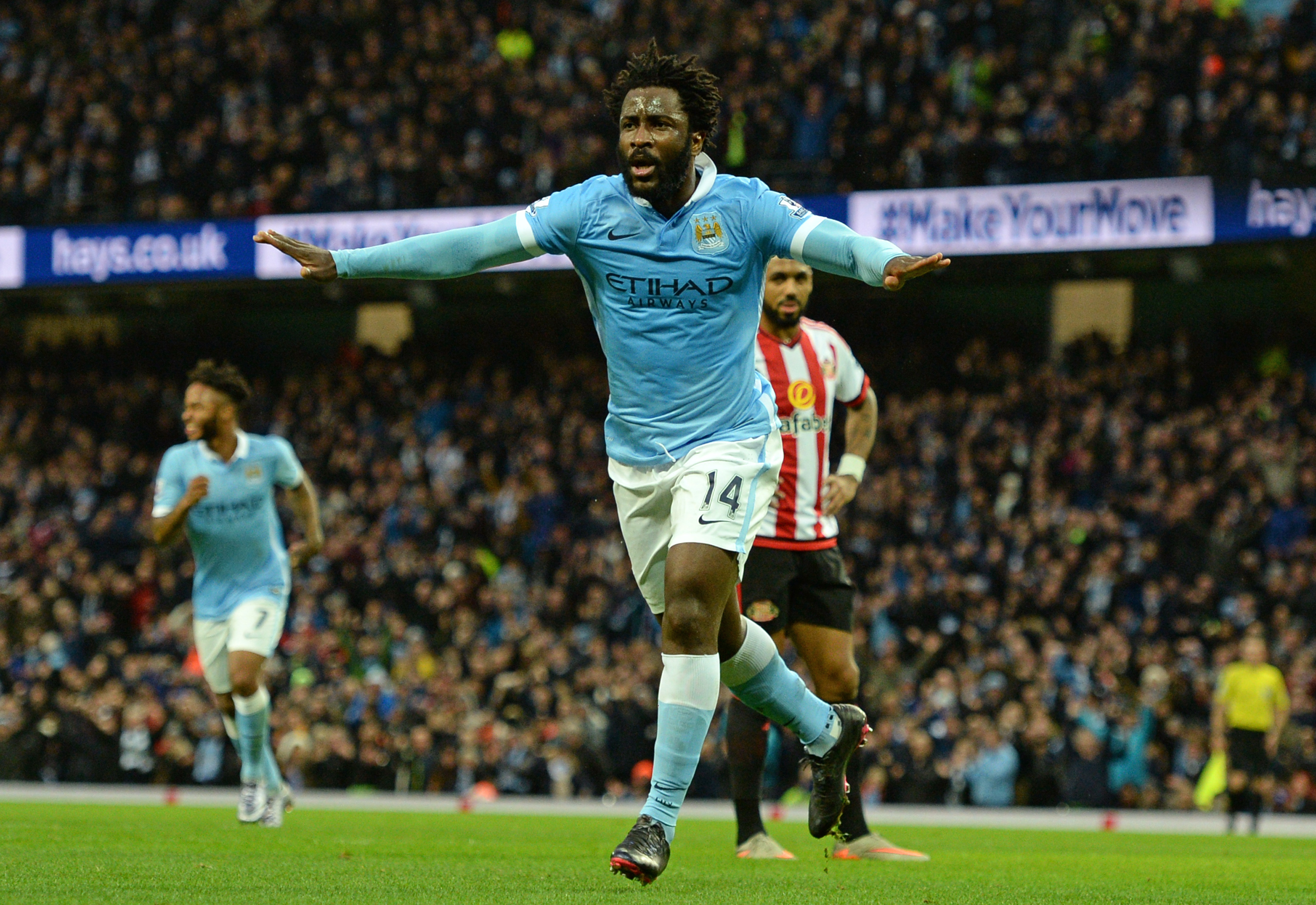 Manchester City's Ivorian striker Wilfried Bony celebrates scoring their third goal during the English Premier League football match between Manchester City and Sunderland at The Etihad stadium in Manchester, north west England on December 26, 2015. AFP PHOTO / OLI SCARFF RESTRICTED TO EDITORIAL USE. No use with unauthorized audio, video, data, fixture lists, club/league logos or 'live' services. Online in-match use limited to 75 images, no video emulation. No use in betting, games or single club/league/player publications. / AFP / OLI SCARFF (Photo credit should read OLI SCARFF/AFP/Getty Images)