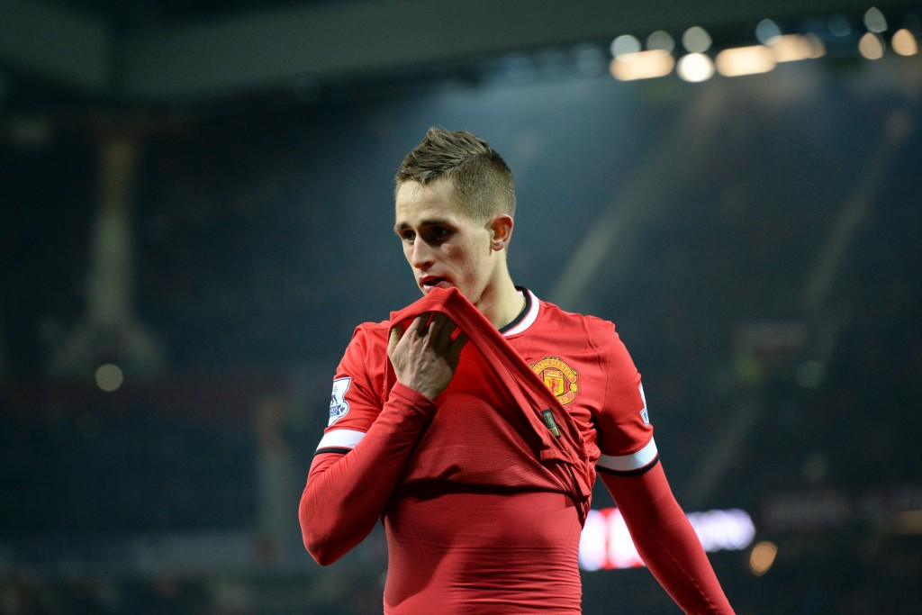 Manchester United's Belgian midfielder Adnan Januzaj wipes his face during the English Premier League football match between Manchester United and Burnley at Old Trafford in Manchester, north west England, on February 11, 2015. Manchester United won the game 3-1.(Photo credit: Oli Scarff/AFP/Getty Images)