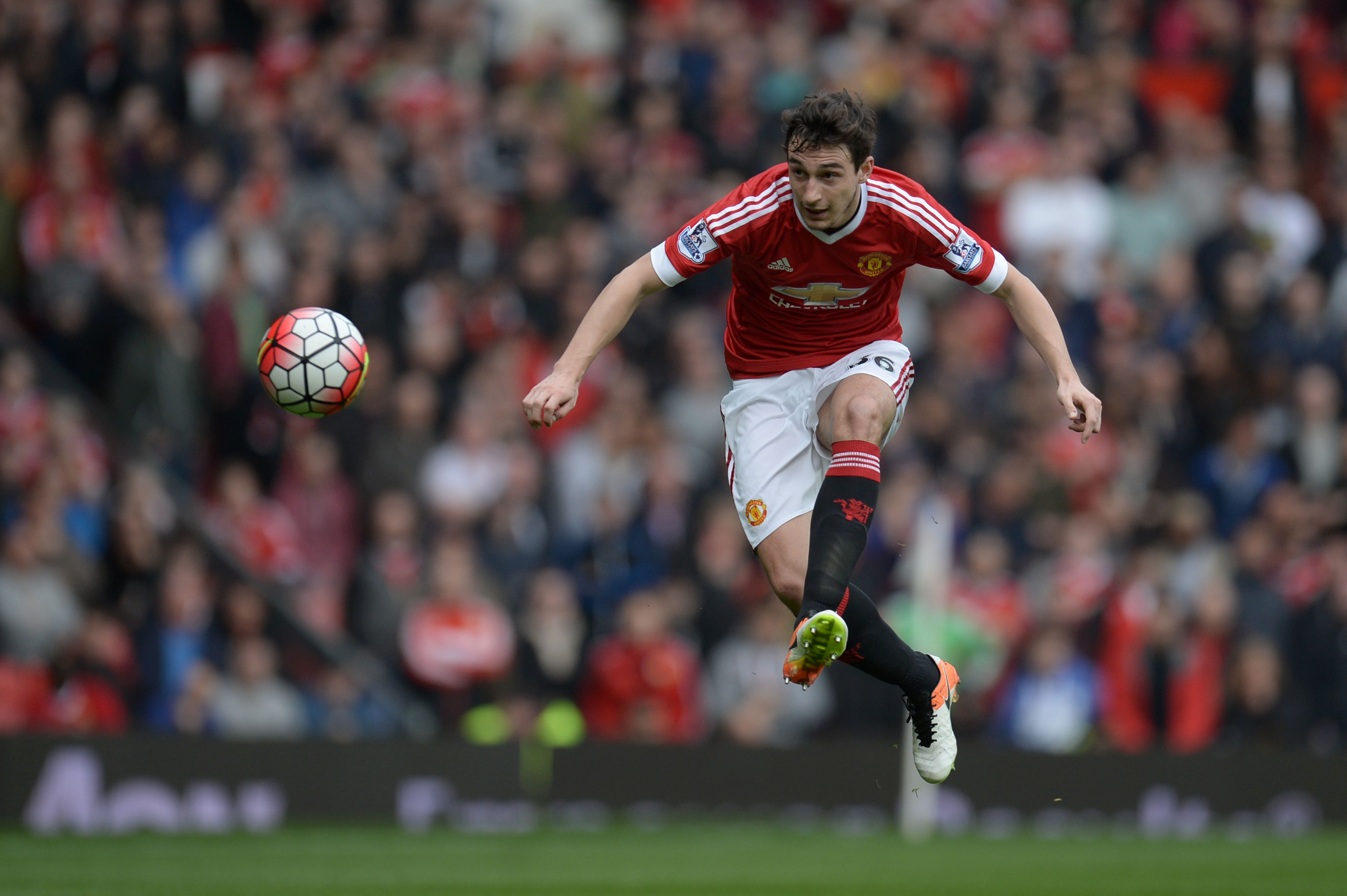 Manchester United's Italian defender Matteo Darmian plays the ball forward during the English Premier League football match between Manchester United and Everton at Old Trafford in Manchester, north west England, on April 3, 2016. / AFP / OLI SCARFF / RESTRICTED TO EDITORIAL USE. No use with unauthorized audio, video, data, fixture lists, club/league logos or 'live' services. Online in-match use limited to 75 images, no video emulation. No use in betting, games or single club/league/player publications. / (Photo credit should read OLI SCARFF/AFP/Getty Images)