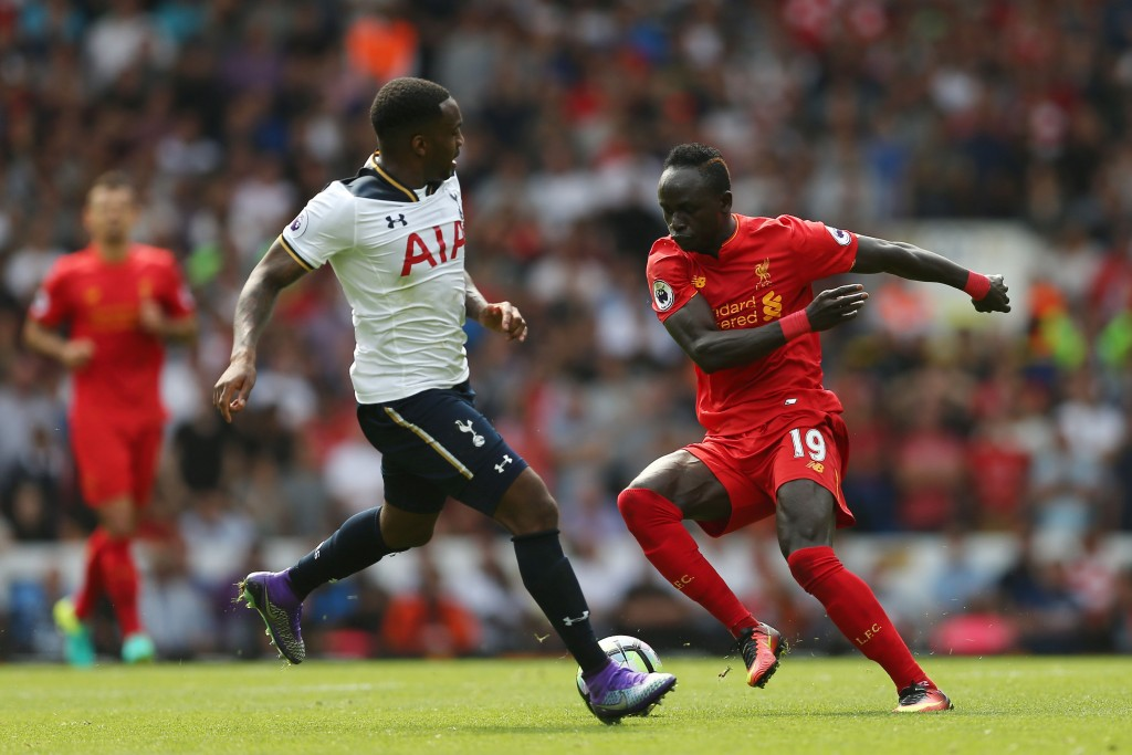 Tottenham Hotspur's English defender Danny Rose (L) vies with Liverpool's Senegalese midfielder Sadio Mane during the English Premier League football match between Tottenham Hotspur and Liverpool at White Hart Lane in London, on August 27, 2016. / AFP / JUSTIN TALLIS / RESTRICTED TO EDITORIAL USE. No use with unauthorized audio, video, data, fixture lists, club/league logos or 'live' services. Online in-match use limited to 75 images, no video emulation. No use in betting, games or single club/league/player publications. / (Photo credit should read JUSTIN TALLIS/AFP/Getty Images)