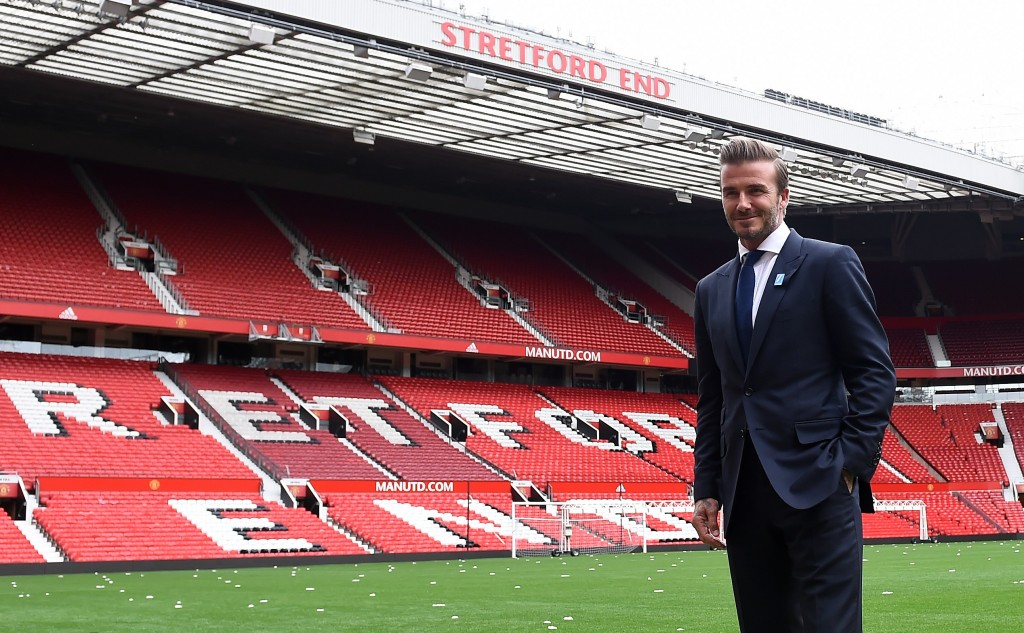 Former Manchester United and England footballer David Beckham poses on the pitch at Old Trafford in Manchester, north west England on October 6, 2015 ahead of a charity football match in aid of UNICEF. Beckham will lead the Great Britain and Ireland team against a Rest of the World team led by Zinedine Zidane at Old Trafford on November 14. AFP PHOTO/PAUL ELLIS (Photo credit should read PAUL ELLIS/AFP/Getty Images)