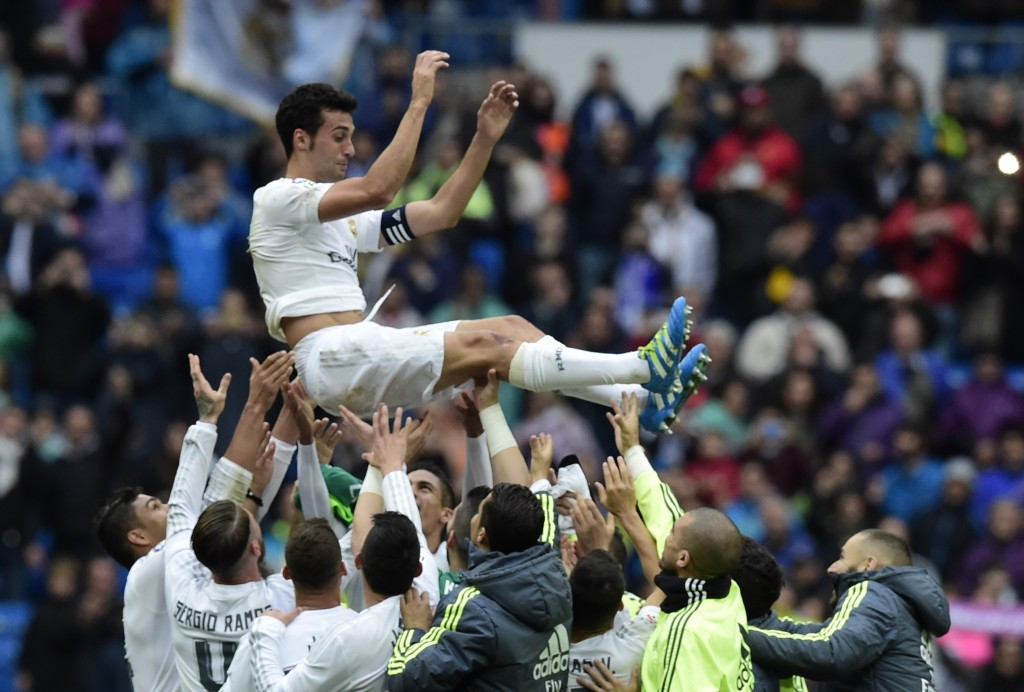 Real Madrid's defender Alvaro Arbeloa (up) celebrates with his teammates his last match for Real Madrid after the Spanish league football match Real Madrid CF vs Valencia CF at the Santiago Bernabeu stadium in Madrid on May 8, 2016. (Photo credit: Javier Soriano/AFP/Getty Images)