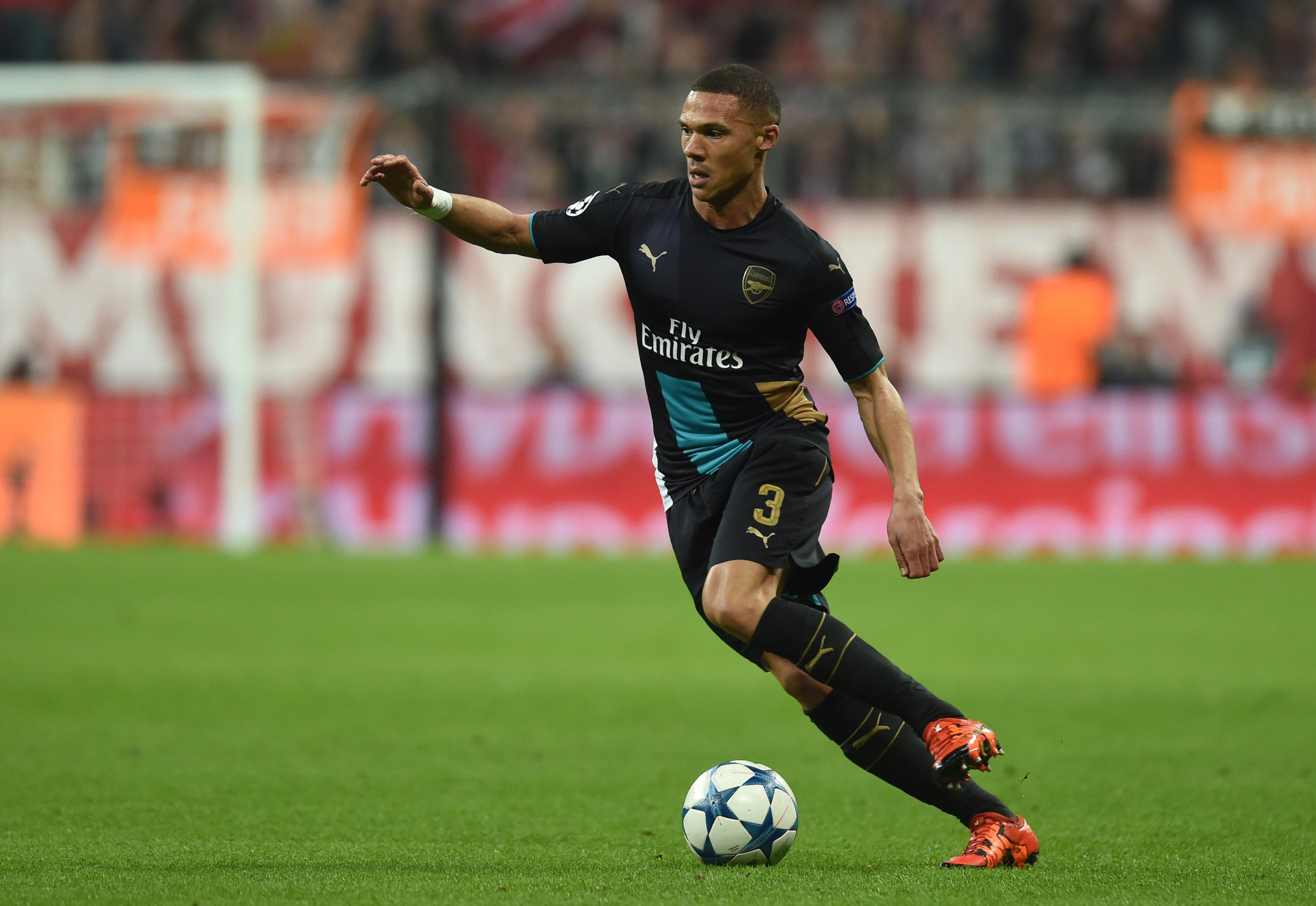 Arsenal's English defender Kieran Gibbs runs with the ball during the UEFA Champions League Group F second-leg football match between FC Bayern Munich and Arsenal FC in Munich, southern Germany, on November 4, 2015. Bayern won the match 5-1. AFP PHOTO / CHRISTOF STACHE (Photo credit should read CHRISTOF STACHE/AFP/Getty Images)