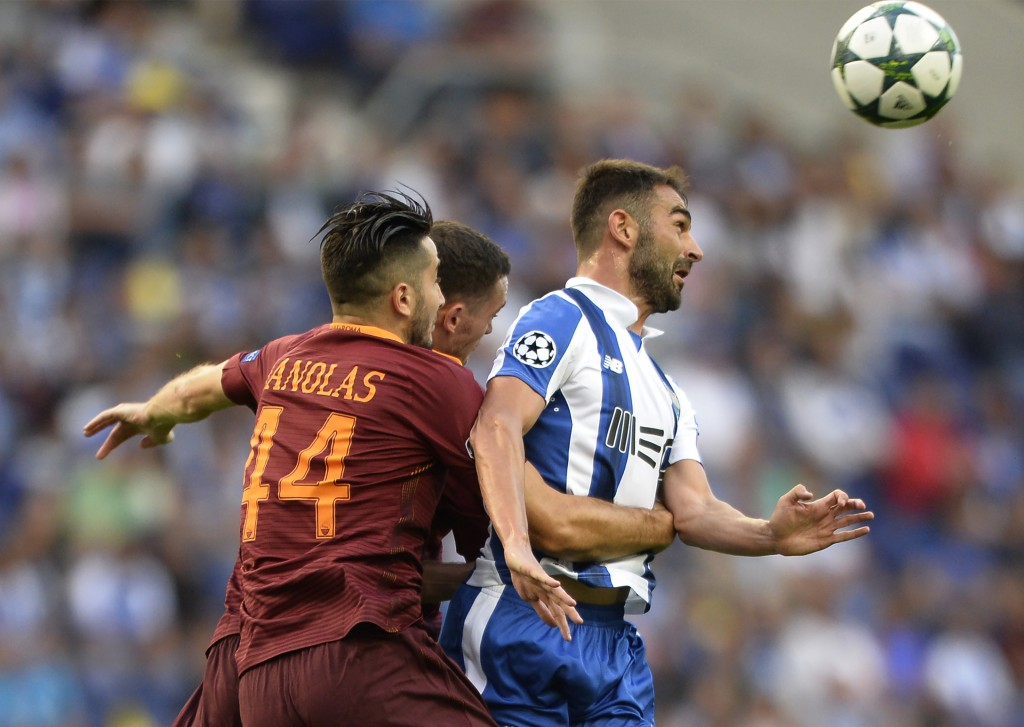 AS Roma's Greek defender Kostas Manolas (L) vies with Porto's Spanish forward Adrian Lopez during the UEFA Champions League first leg play off football match FC Porto vs AS Roma at the Dragao stadium in Porto on August 17, 2016. / AFP / MIGUEL RIOPA (Photo credit should read MIGUEL RIOPA/AFP/Getty Images)