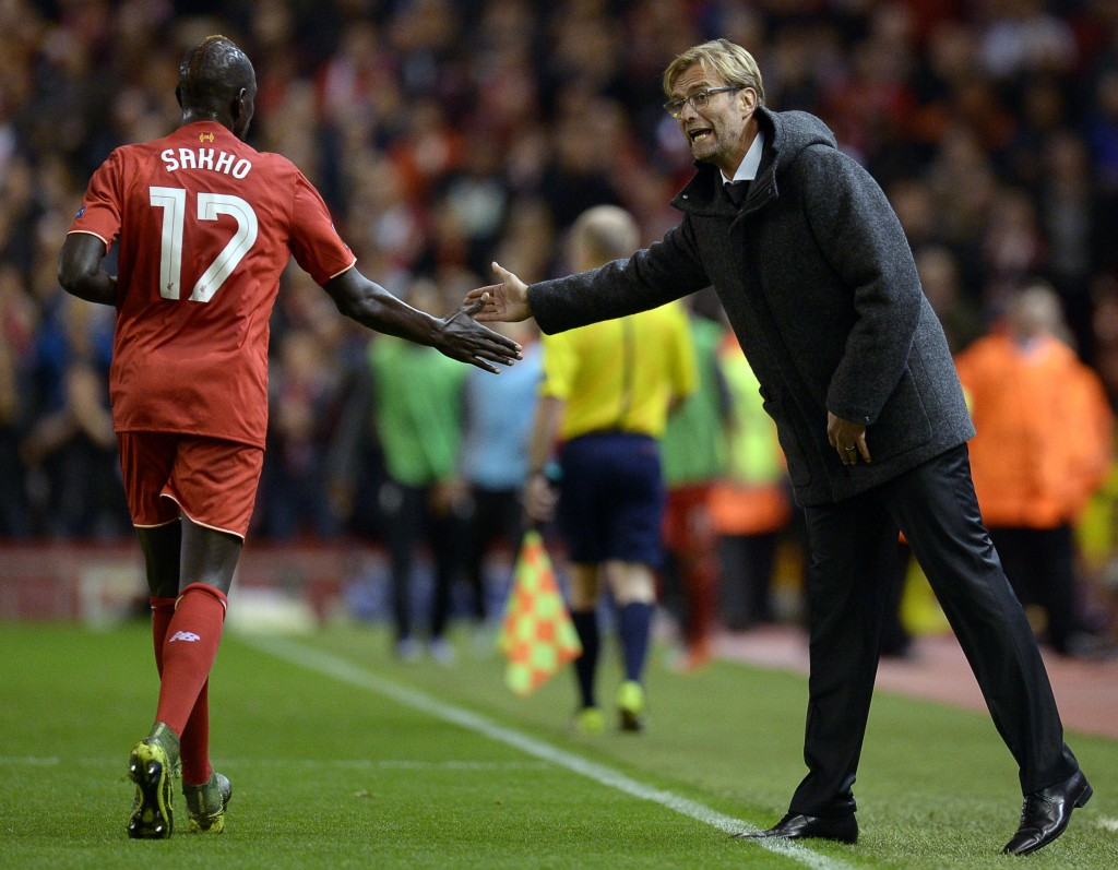 Liverpool's German manager Jurgen Klopp (R) taps hands with Liverpool's French defender Mamadou Sakho during a UEFA Europa League group B football match between Liverpool FC and FC Rubin Kazan at Anfield in Liverpool, north west England, on October 22, 2015. AFP PHOTO / OLI SCARFF (Photo credit should read OLI SCARFF/AFP/Getty Images)
