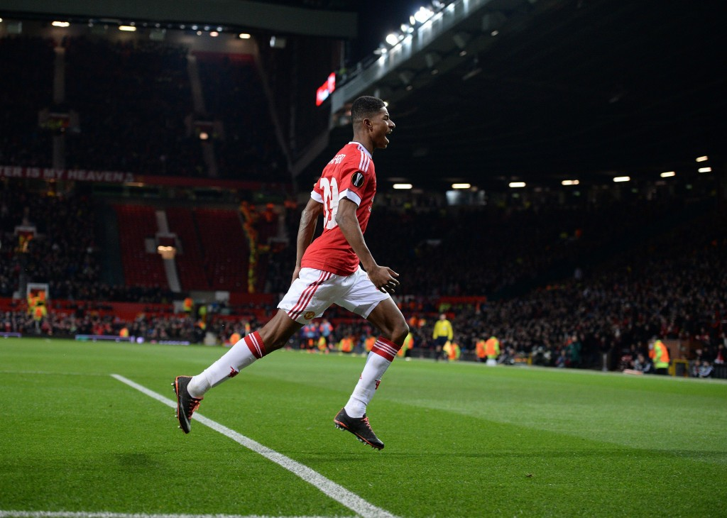 Manchester United's English striker Marcus Rashford (C) celebrates scoring his team's second goal during the UEFA Europa League round of 32, second leg football match between Manchester United and and FC Midtjylland at Old Trafford in Manchester, north west England, on February 25, 2016. / AFP / OLI SCARFF (Photo credit should read OLI SCARFF/AFP/Getty Images)