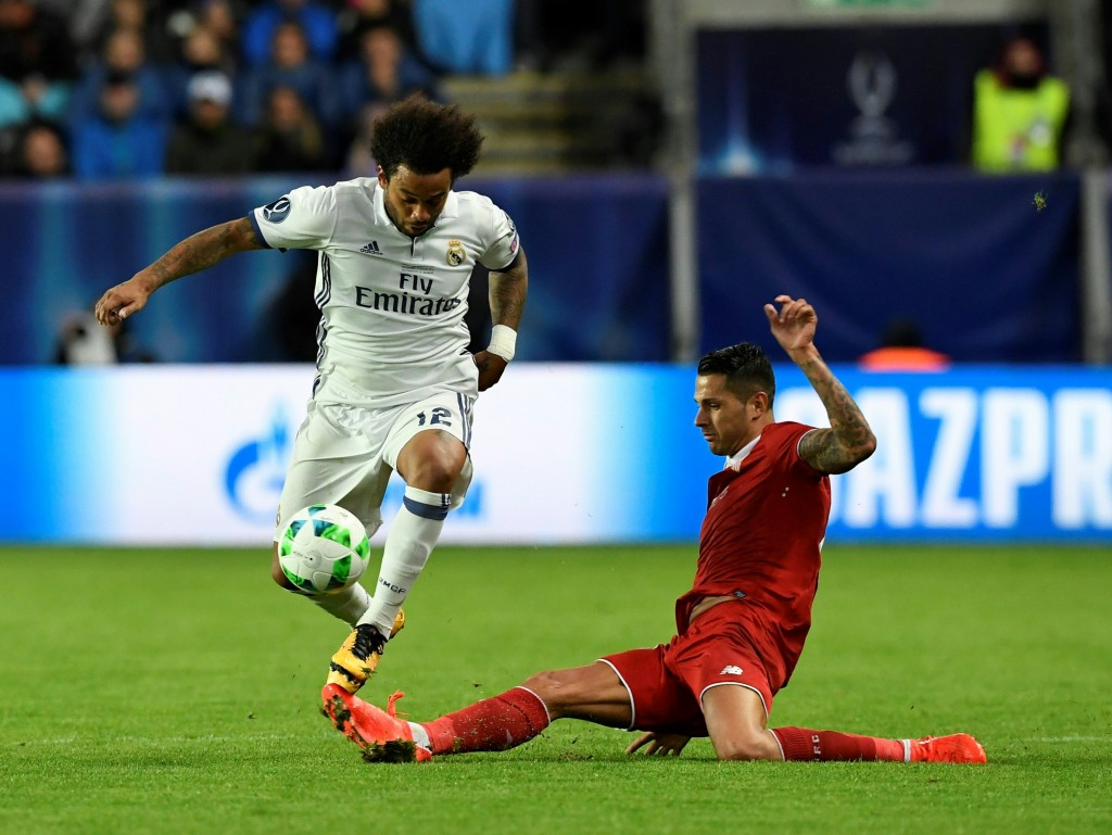 Real Madrid's Brazilian defender Marcelo (L) and Sevilla's Spanish midfielder Vitolo vie for the ball during the UEFA Super Cup final football match between Real Madrid CF and Sevilla FC on August 9, 2016 at the Lerkendal Stadium in Trondheim. / AFP / JONATHAN NACKSTRAND (Photo credit should read JONATHAN NACKSTRAND/AFP/Getty Images)