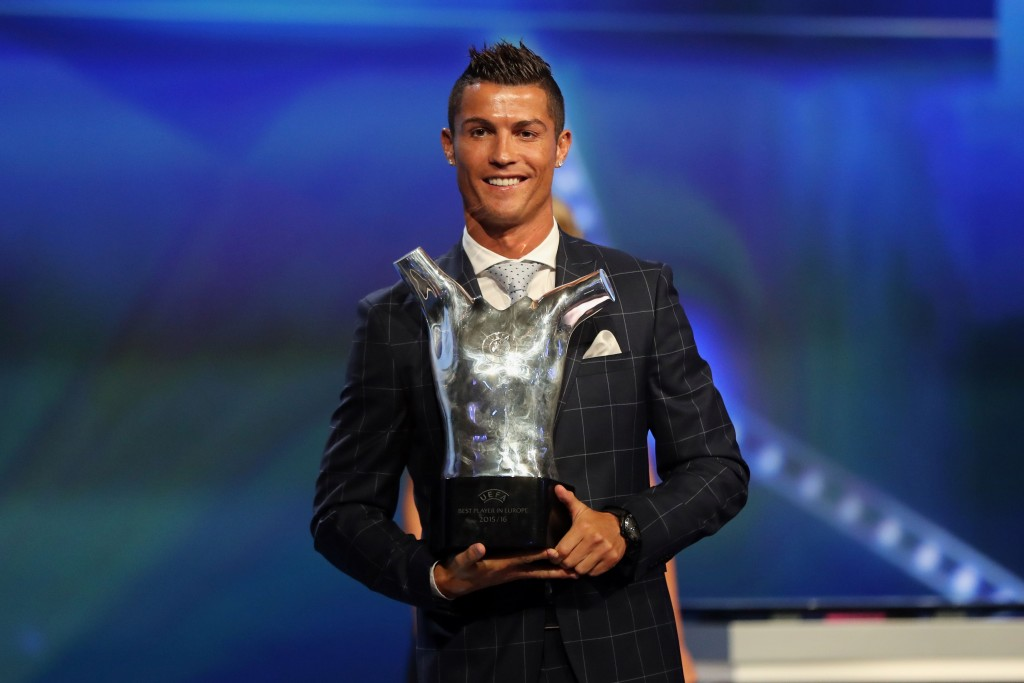 Real Madrid's Portuguese forward Cristiano Ronaldo holds his trophy of Best Men's player in Europe at the end of the UEFA Champions League Group stage draw ceremony, on August 25, 2016 in Monaco. (Photo credit: Valery Hache/AFP/Getty Images)