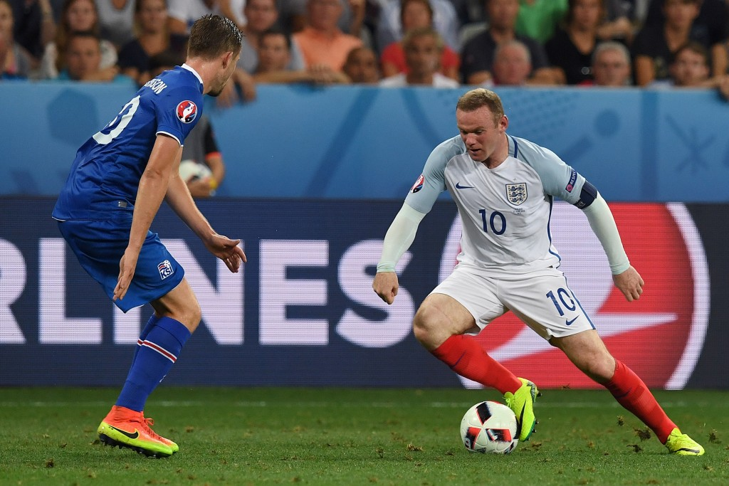 Iceland's midfielder Gylfi Sigurdsson eyes the ball played by England's forward Wayne Rooney during Euro 2016 round of 16 football match between England and Iceland at the Allianz Riviera stadium in Nice on June 27, 2016. / AFP / PAUL ELLIS (Photo credit should read PAUL ELLIS/AFP/Getty Images)