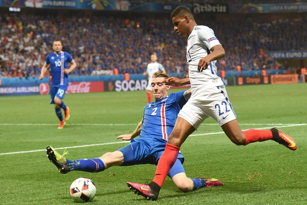 Iceland's defender Birkir Saevarsson (L) vies for the ball against England's forward Marcus Rashford during Euro 2016 round of 16 football match between England and Iceland at the Allianz Riviera stadium in Nice on June 27, 2016. / AFP / PAUL ELLIS (Photo credit should read PAUL ELLIS/AFP/Getty Images)
