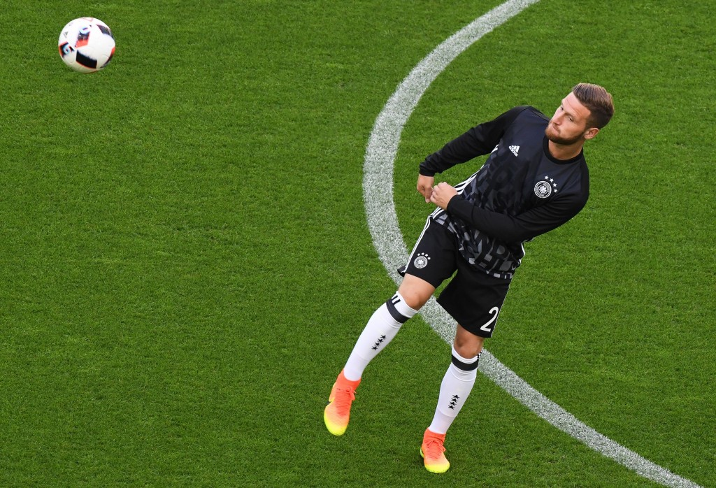 Germany's defender Shkodran Mustafi warms up before the Euro 2016 quarter-final football match between Germany and Italy at the Matmut Atlantique stadium in Bordeaux on July 2, 2016. / AFP / MEHDI FEDOUACH (Photo credit should read MEHDI FEDOUACH/AFP/Getty Images)