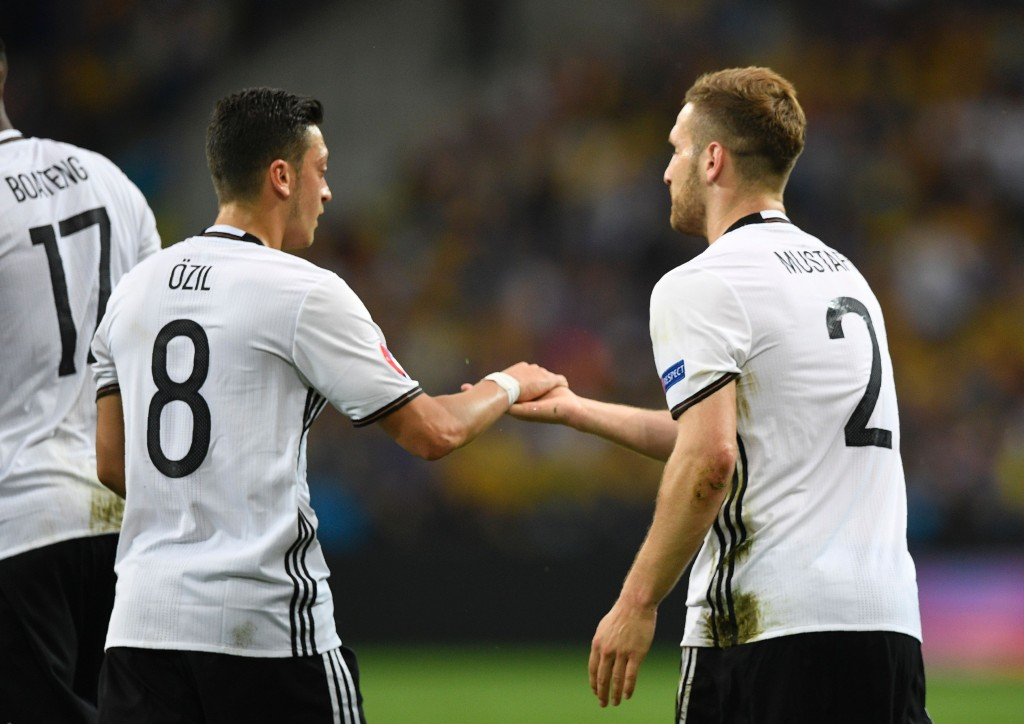 Germany's defender Shkodran Mustafi (R) celebrates with Germany's midfielder Mesut Oezil after scoring a goal during the Euro 2016 group C football match between Germany and Ukraine at the Stade Pierre Mauroy in Villeneuve-d'Ascq near Lille on June 12, 2016. / AFP / MARTIN BUREAU (Photo credit should read MARTIN BUREAU/AFP/Getty Images)