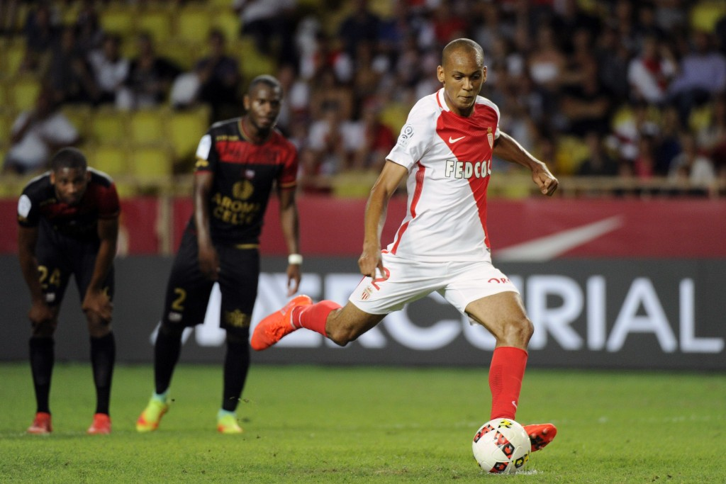 Monacos Brazilian midfielder Fabinho scores a penalty goal during the French L1 football match between Monaco and Guingamp on August 12, 2016, at the Louis II stadium in Monaco. / AFP / Franck PENNANT (Photo credit should read FRANCK PENNANT/AFP/Getty Images)
