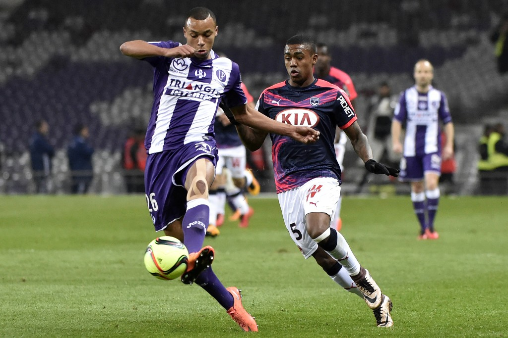 Toulouse's Congolese defender Marcel Tisserand (L) vies with Bordeaux's French forward Malcom during the French L1 football match between Toulouse and Bordeaux at the Municipal Stadium in Toulouse on March 12, 2016. AFP PHOTO / PASCAL PAVANI / AFP / PASCAL PAVANI (Photo credit should read PASCAL PAVANI/AFP/Getty Images)