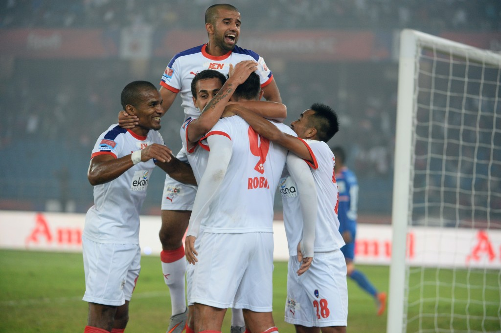 Delhi Dynamos FC forward Robin Singh (C) celebrates with teammates after scoring during the first leg of the semi-final football match between Delhi Dynamos FC and FC Goa of Indian Super League (ISL) at Jawahar Lal Nehru Stadium in New Delhi on December 11, 2015. AFP PHOTO / SAJJAD HUSSAIN / AFP / SAJJAD HUSSAIN (Photo credit should read SAJJAD HUSSAIN/AFP/Getty Images)