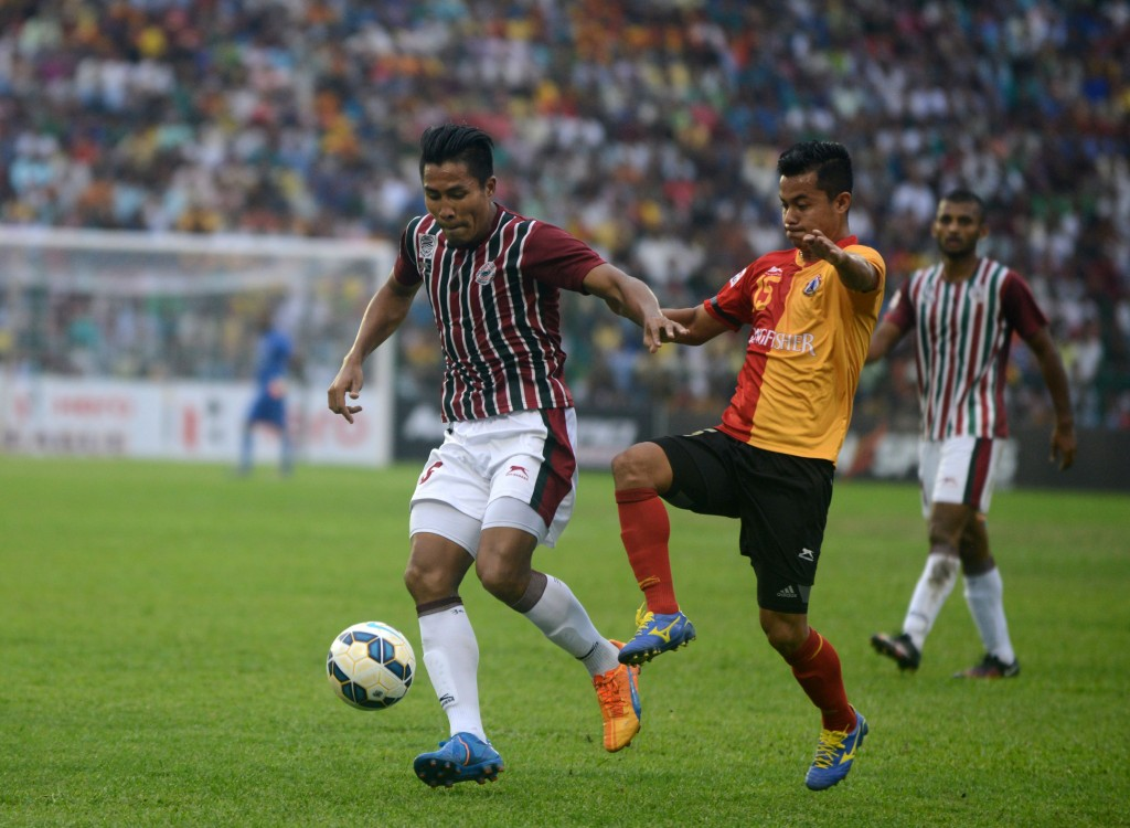Mohun Bagan Dhanachandra Singh(L) is tackled by East Bengal's Sanju Pradhan(R) during an I-League football match at The Kanchenjungha Stadium in Siliguri on April 2, 2016. East Bengal won the match 2-1. / AFP / DIPTENDU DUTTA (Photo credit should read DIPTENDU DUTTA/AFP/Getty Images)