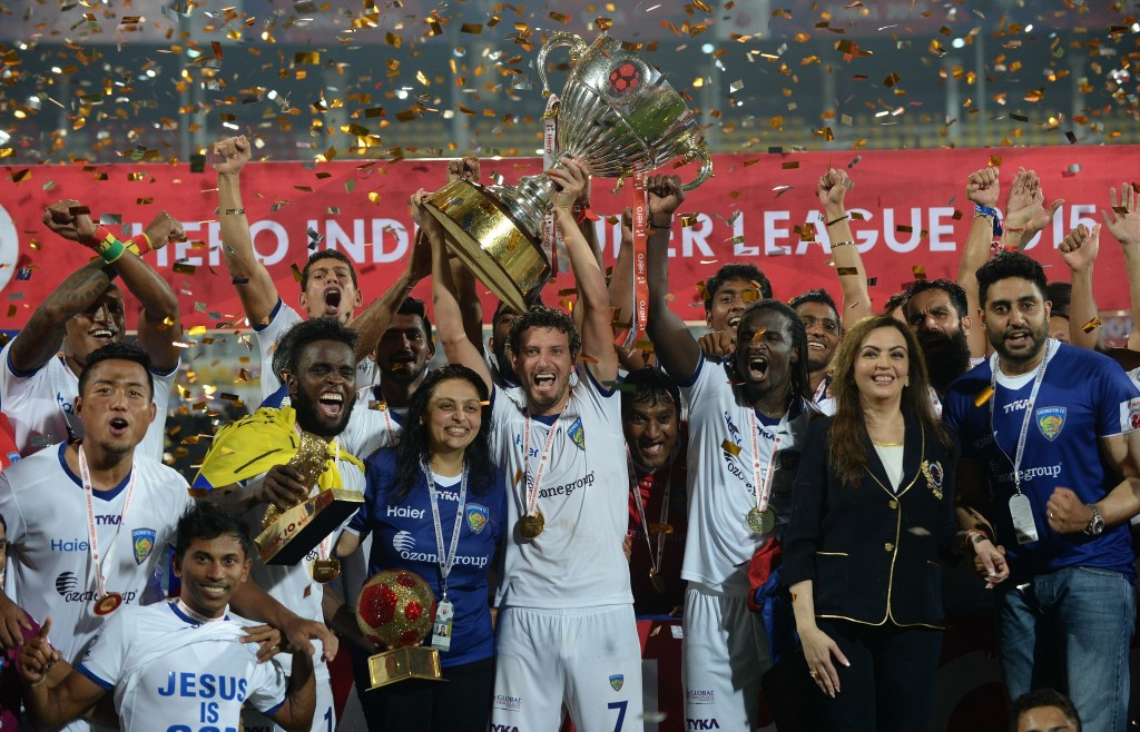Chennaiyin FC players pose with the trophy as they celebrate along with Bollywood actor Abhishek Bachchan (R) and Nita Ambani (3R) after winning the final match against FC Goa during the Indian Super League (ISL) football tournament at Jawahar Lal Nehru Stadium in Goa on December 20, 2015. AFP PHOTO / PUNIT PARANJPE / AFP / PUNIT PARANJPE (Photo credit should read PUNIT PARANJPE/AFP/Getty Images)