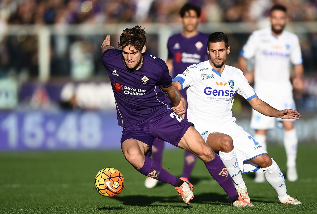Empoli's defender from France Vincent Laurini vies with Fiorentina's defender from Spain Marcos Alonso Mendoza (L) during the Italian Serie A football match Fiorentina vs Empoli at the Artemio Franchi Stadium on November 22, 2015 in Florence. AFP PHOTO / FILIPPO MONTEFORTE (Photo credit should read FILIPPO MONTEFORTE/AFP/Getty Images)