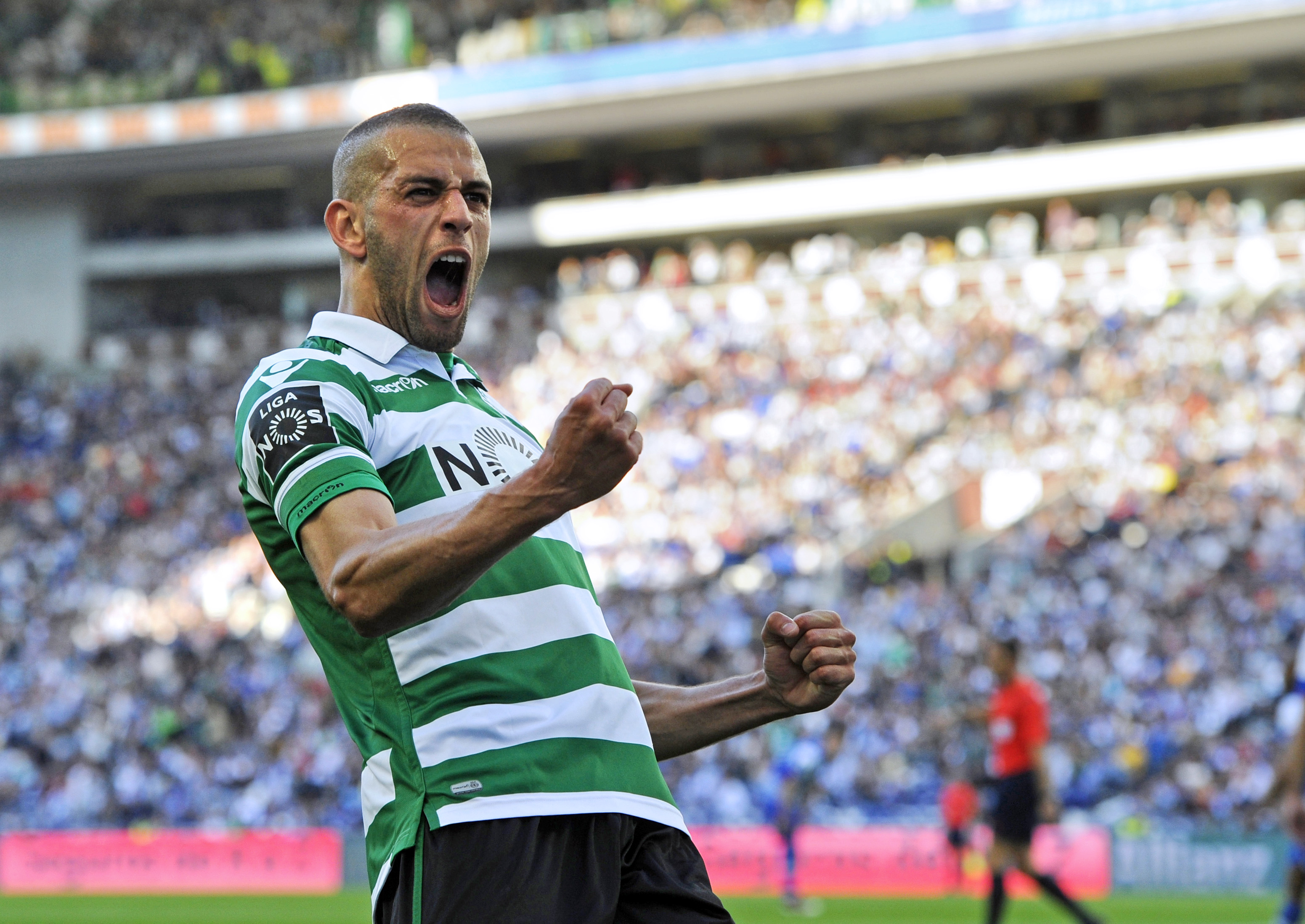 Sporting's Algerian forward Islam Slimani celebrates a goal during the Portuguese league football match FC Porto vs Sporting CP at the Dragao stadium in Porto on April 30, 2016. / AFP / MIGUEL RIOPA (Photo credit should read MIGUEL RIOPA/AFP/Getty Images)