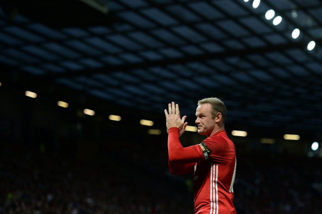 Manchester United's English striker Wayne Rooney applauds during the friendly Wayne Rooney testimonial football match between Manchester United and Everton at Old Trafford in Manchester, northwest England, on August 3, 2016. (Photo by Oli Scarff/AFP/Getty Images)