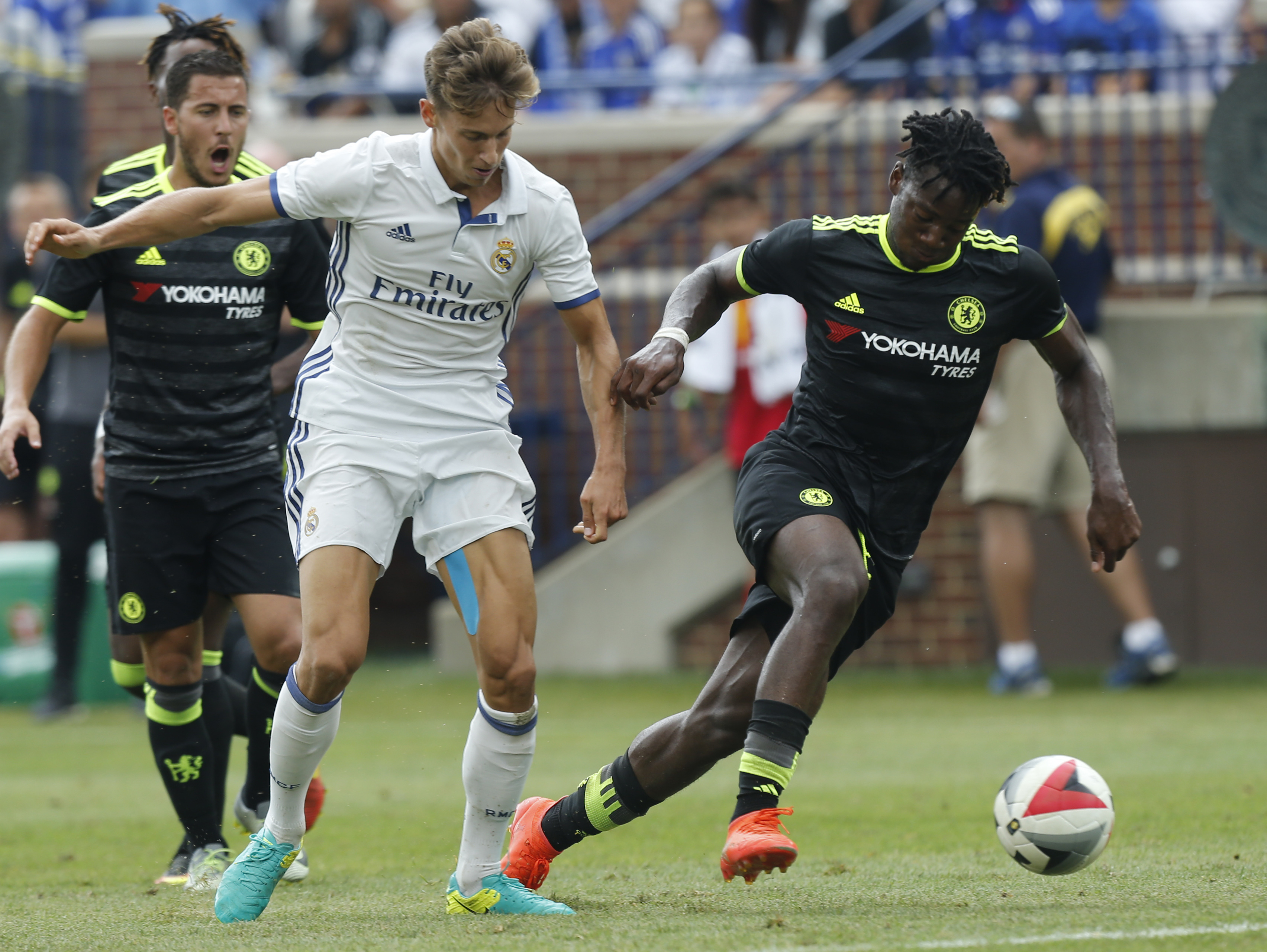 Chelsea forward Michy Batshuayi (R) and Real Real Madrid midfielder Marcos Llorente (L) chase a loose ball during an International Champions Cup soccer match in Ann Arbor, Michigan on July 30, 2016. / AFP / Jay LaPrete (Photo credit should read JAY LAPRETE/AFP/Getty Images)