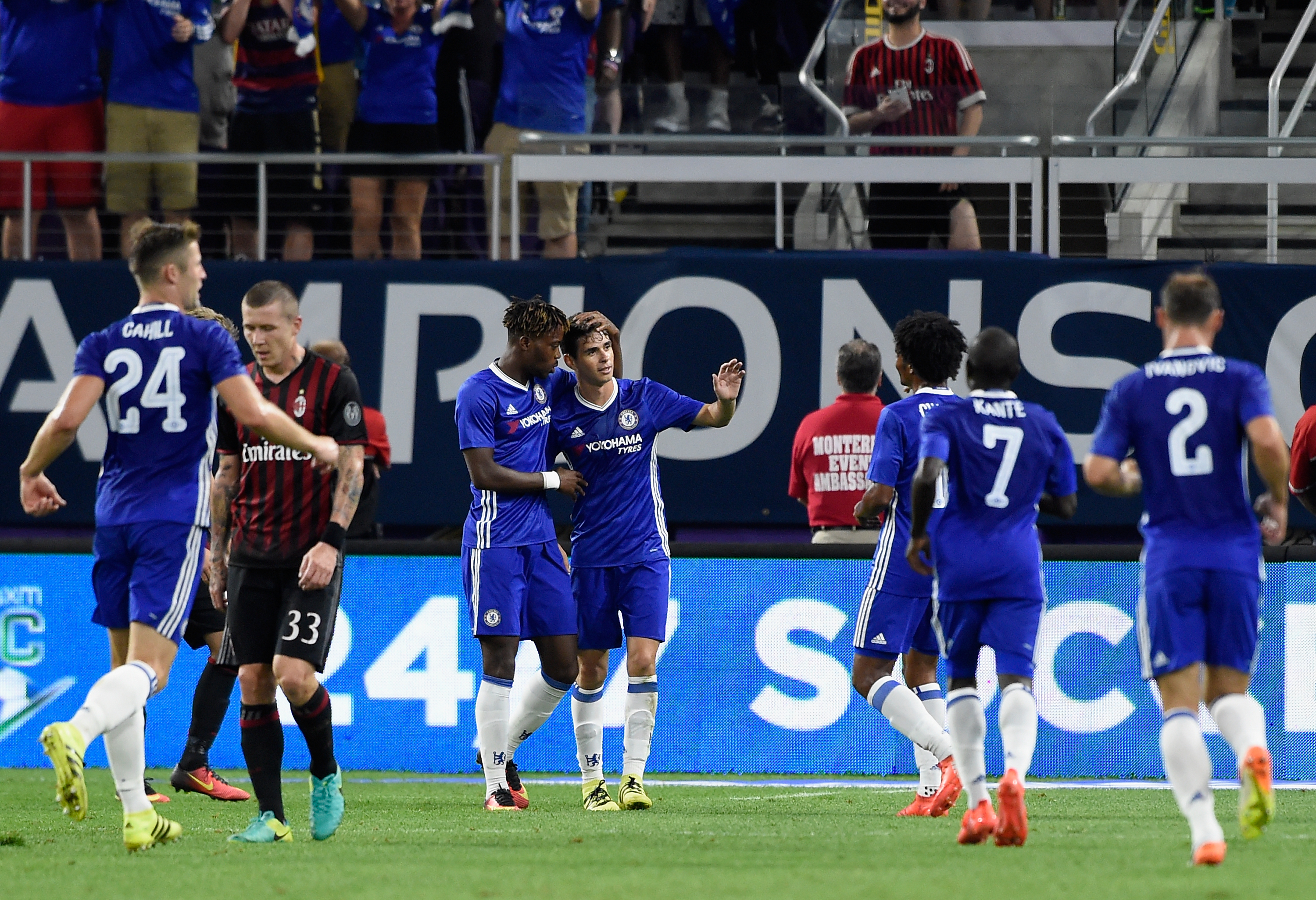 MINNEAPOLIS, MN - AUGUST 3: Chelsea celebrates a goal by Oscar #8 as Juraj Kucka #33 of AC Milan looks on during the second half of the International Champions Cup match on August 3, 2016 at U.S. Bank Stadium in Minneapolis, Minnesota. Chelsea defeat AC Milan 3-1. (Photo by Hannah Foslien/Getty Images)