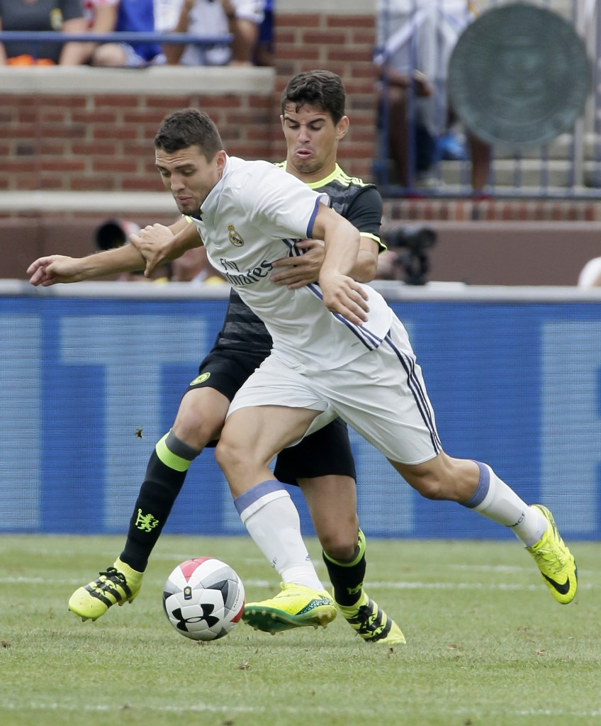 ANN ARBOR, MI - JULY 30: Marco Asensio #28 of Real Madrid is held by Oscar #8 of Chelsea during the first half at Michigan Stadium on July 30, 2016 in Ann Arbor, Michigan. (Photo by Duane Burleson/Getty Images)