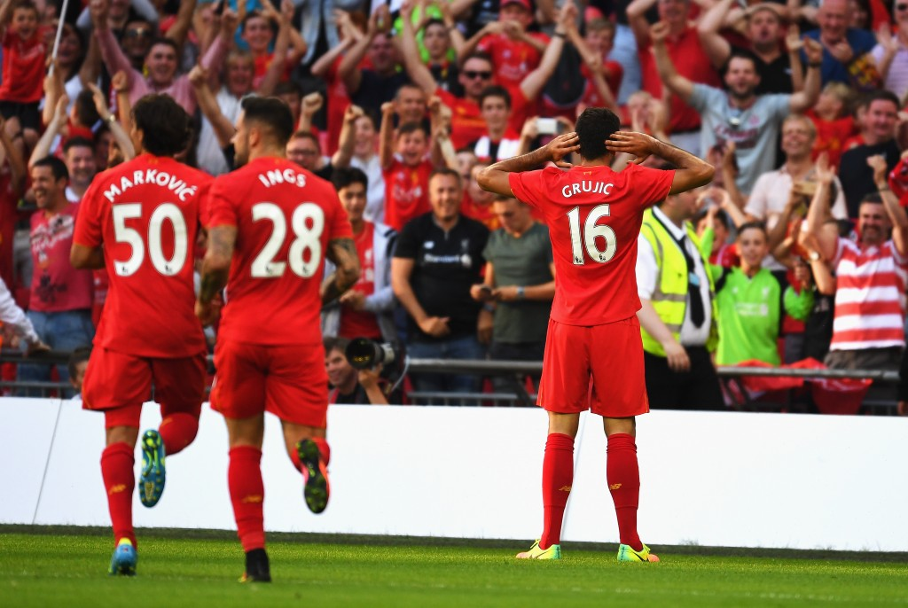 LONDON, ENGLAND - AUGUST 06: Marko Grujic of Liverpool celebrates scoring his team's fourth goal during the International Champions Cup match between Liverpool and Barcelona at Wembley Stadium on August 6, 2016 in London, England. (Photo by Mike Hewitt/Getty Images)