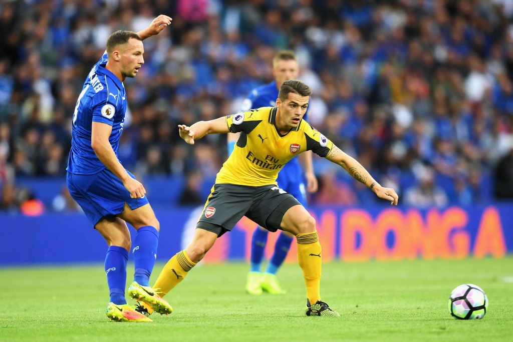 LEICESTER, ENGLAND - AUGUST 20: Daniel Drinkwater of Leicester City and Granit Xhaka of Arsenal watch the ball during the Premier League match between Leicester City and Arsenal at The King Power Stadium on August 20, 2016 in Leicester, England. (Photo by Michael Regan/Getty Images)