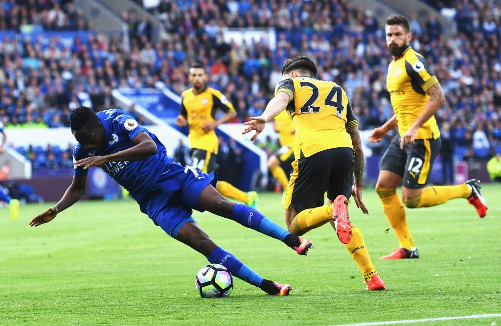 LEICESTER, ENGLAND - AUGUST 20: Ahmed Musa of Leicester City is taken down by Hector Bellerin of Arsenal during the Premier League match between Leicester City and Arsenal at The King Power Stadium on August 20, 2016 in Leicester, England. (Photo by Michael Regan/Getty Images)