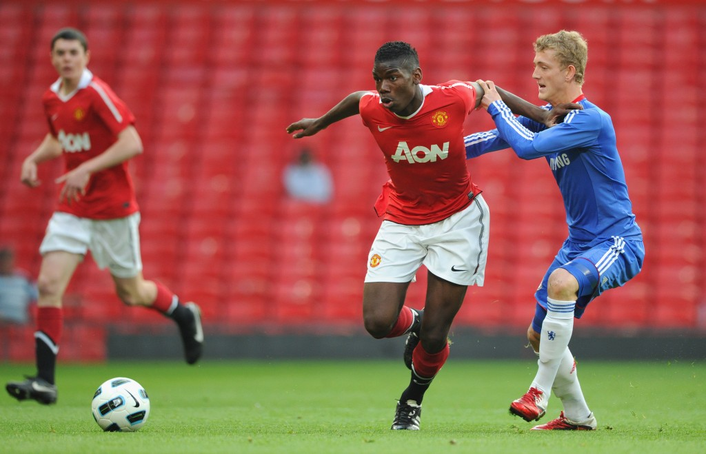 MANCHESTER, ENGLAND - APRIL 20: Bobby Devyne of Chelsea battles Paul Pogba of Manchester United during the FA Youth Cup Semi Final 2nd Leg between Manchester United and Chelsea at Old Trafford on April 20, 2011 in Manchester, England. (Photo by Michael Regan/Getty Images)