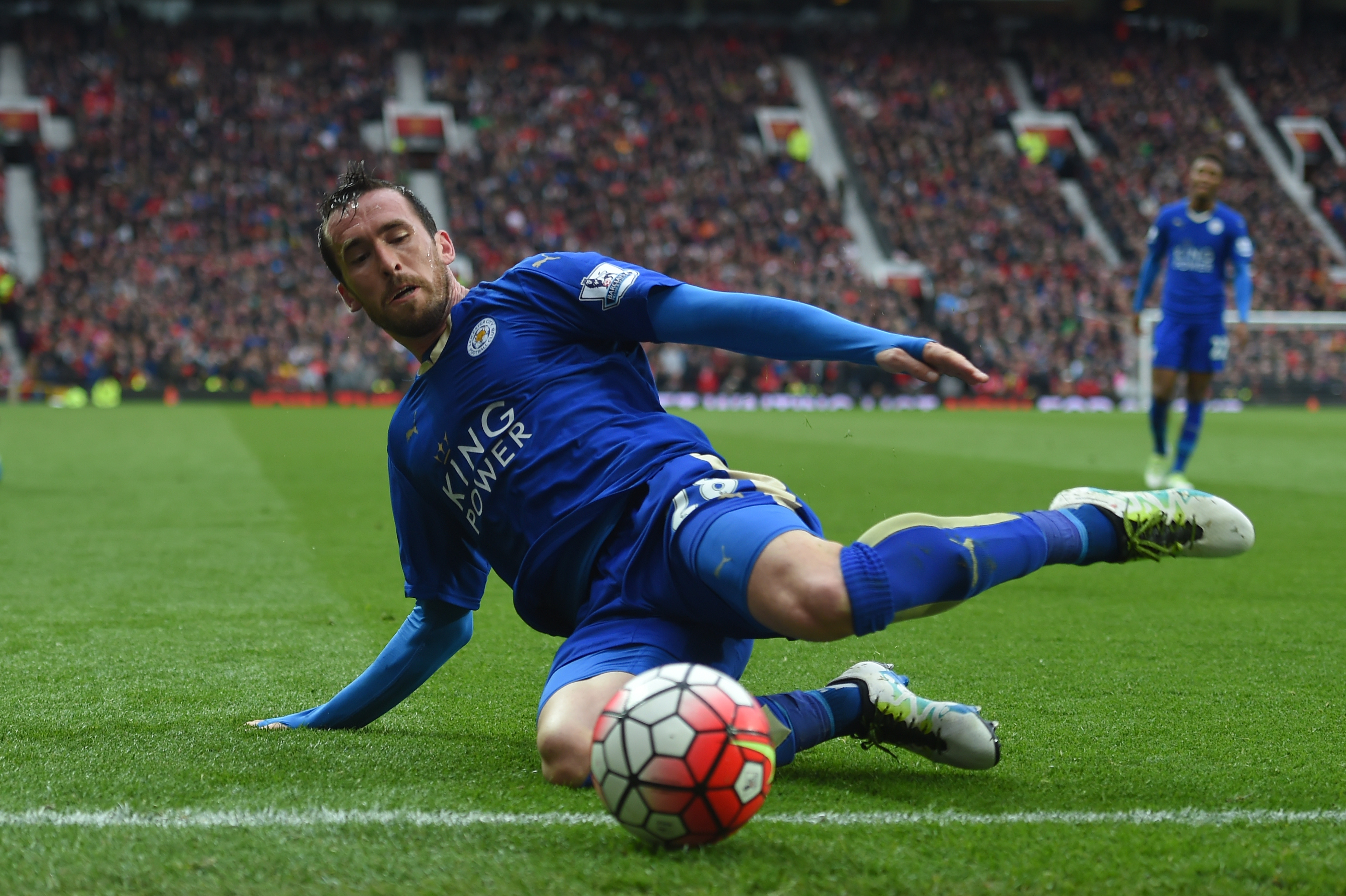 MANCHESTER, ENGLAND - MAY 01: Christian Fuchs of Leicester City slides for the ball during the Barclays Premier League match between Manchester United and Leicester City at Old Trafford on May 1, 2016 in Manchester, England. (Photo by Michael Regan/Getty Images)