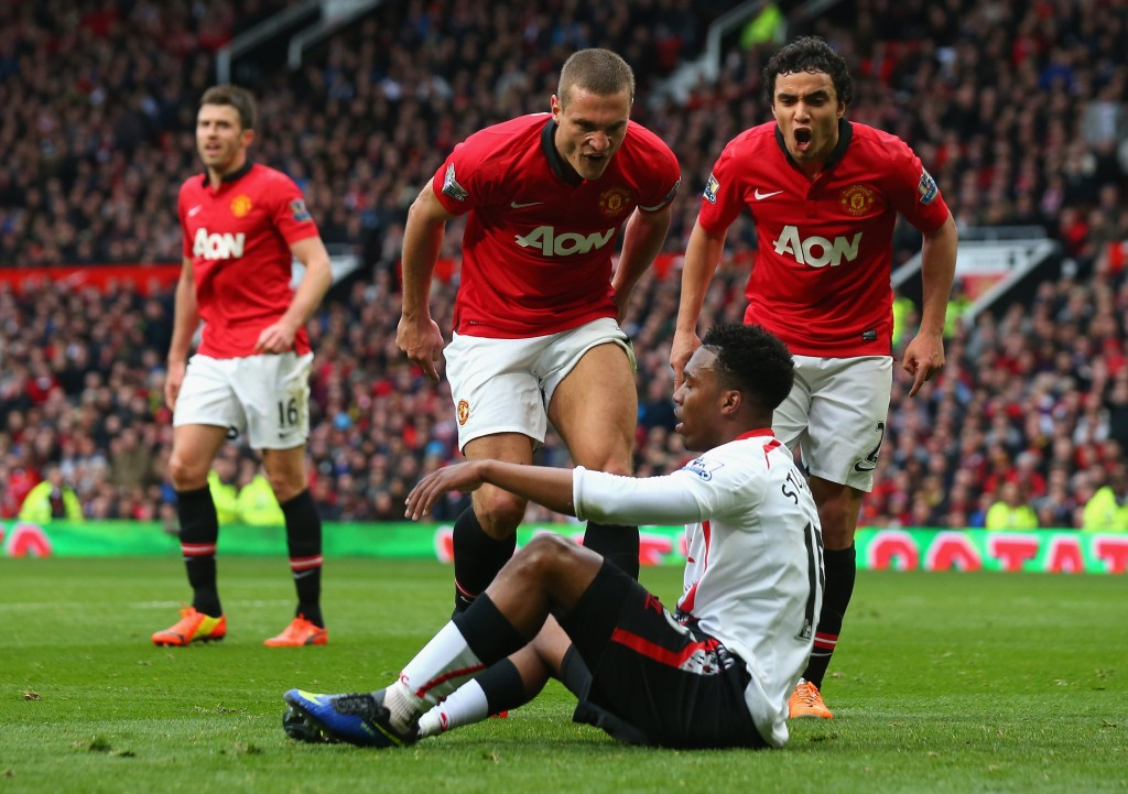 MANCHESTER, ENGLAND - MARCH 16: Nemanja Vidic of Manchester United and Rafael (R) react to Daniel Sturridge of Liverpool after the award of the second penalty kick during the Barclays Premier League match between Manchester United and Liverpool at Old Trafford on March 16, 2014 in Manchester, England. (Photo by Alex Livesey/Getty Images)