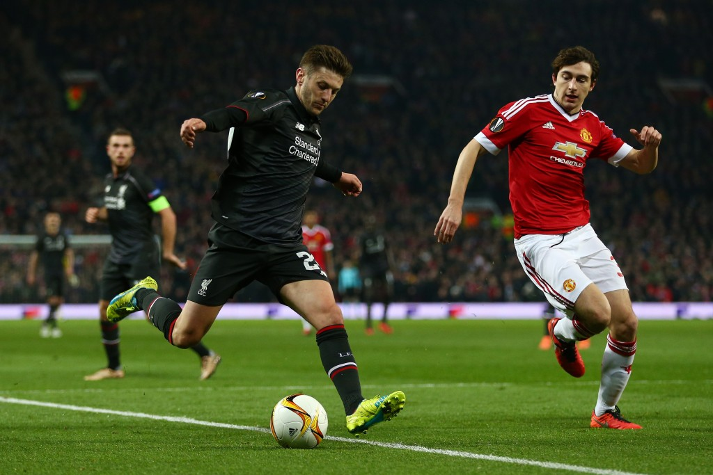 MANCHESTER, ENGLAND - MARCH 17: Adam Lallana of Liverpool is faced by Matteo Darmian of Manchester United during the UEFA Europa League round of 16, second leg match between Manchester United and Liverpool at Old Trafford on March 17, 2016 in Manchester, England. (Photo by Clive Brunskill/Getty Images)