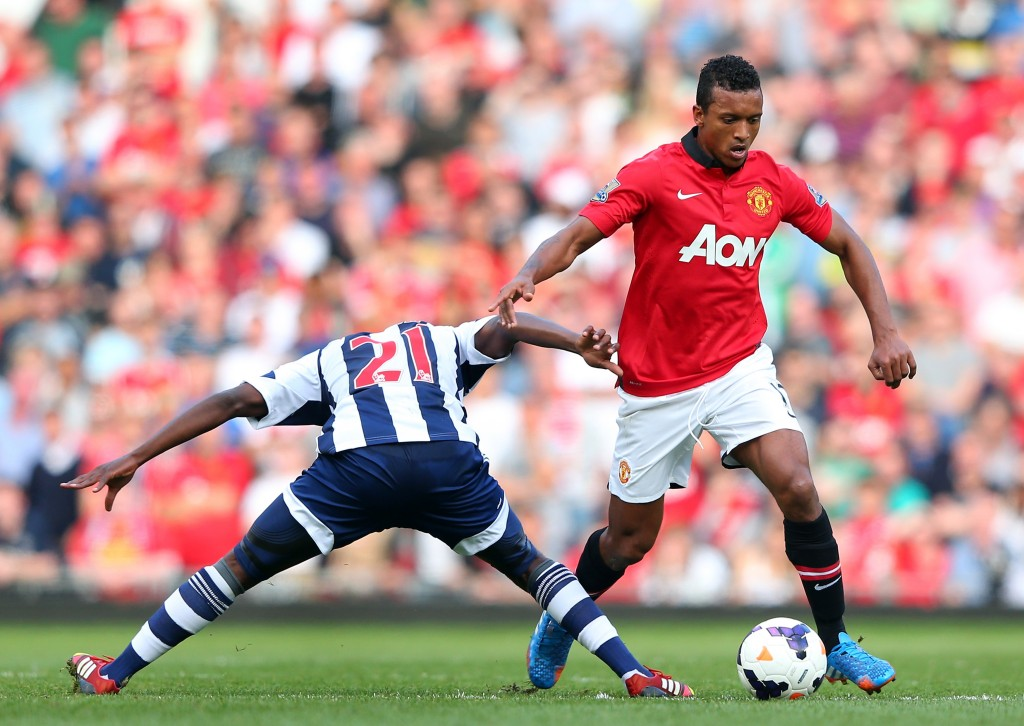 MANCHESTER, ENGLAND - SEPTEMBER 28: Nani of Manchester United beats Youssouf Mulumbu of West Bromwich Albion during the Barclays Premier League match between Manchester United and West Bromwich Albion at Old Trafford on September 28, 2013 in Manchester, England. (Photo by Alex Livesey/Getty Images)