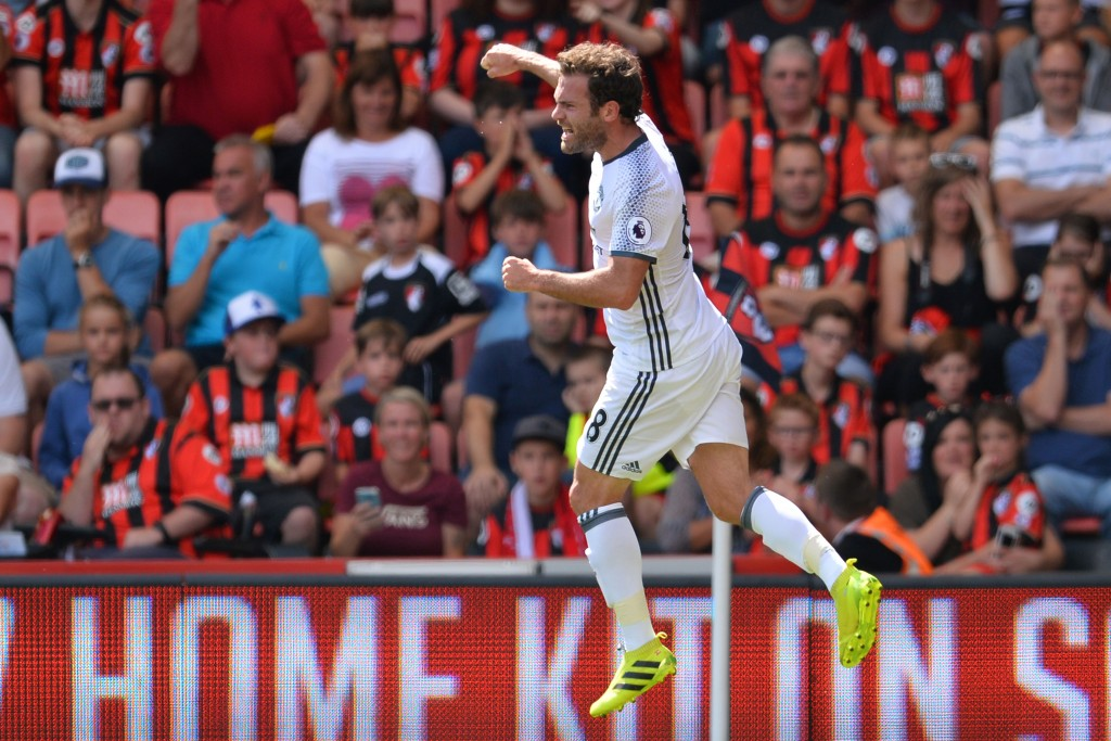 Manchester United's Spanish midfielder Juan Mata celerbates scoring the opening goal during the English Premier League football match between Bournemouth and Manchester United at the Vitality Stadium in Bournemouth, southern England on August 14, 2016. / AFP / GLYN KIRK / RESTRICTED TO EDITORIAL USE. No use with unauthorized audio, video, data, fixture lists, club/league logos or 'live' services. Online in-match use limited to 75 images, no video emulation. No use in betting, games or single club/league/player publications.  /         (Photo credit should read GLYN KIRK/AFP/Getty Images)
