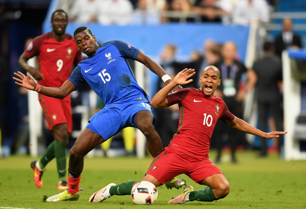 PARIS, FRANCE - JULY 10:  Joao Mario of Portugal and Paul Pogba of France compete for the ball during the UEFA EURO 2016 Final match between Portugal and France at Stade de France on July 10, 2016 in Paris, France.  (Photo by Michael Regan/Getty Images)