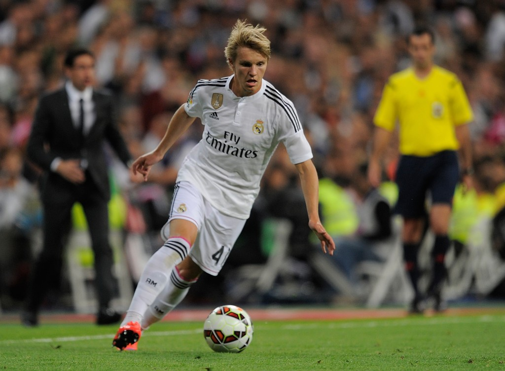 Ødegaard showed signs of better things to come in his first competitive start for Madrid. (Picture Courtesy - AFP/Getty Images)