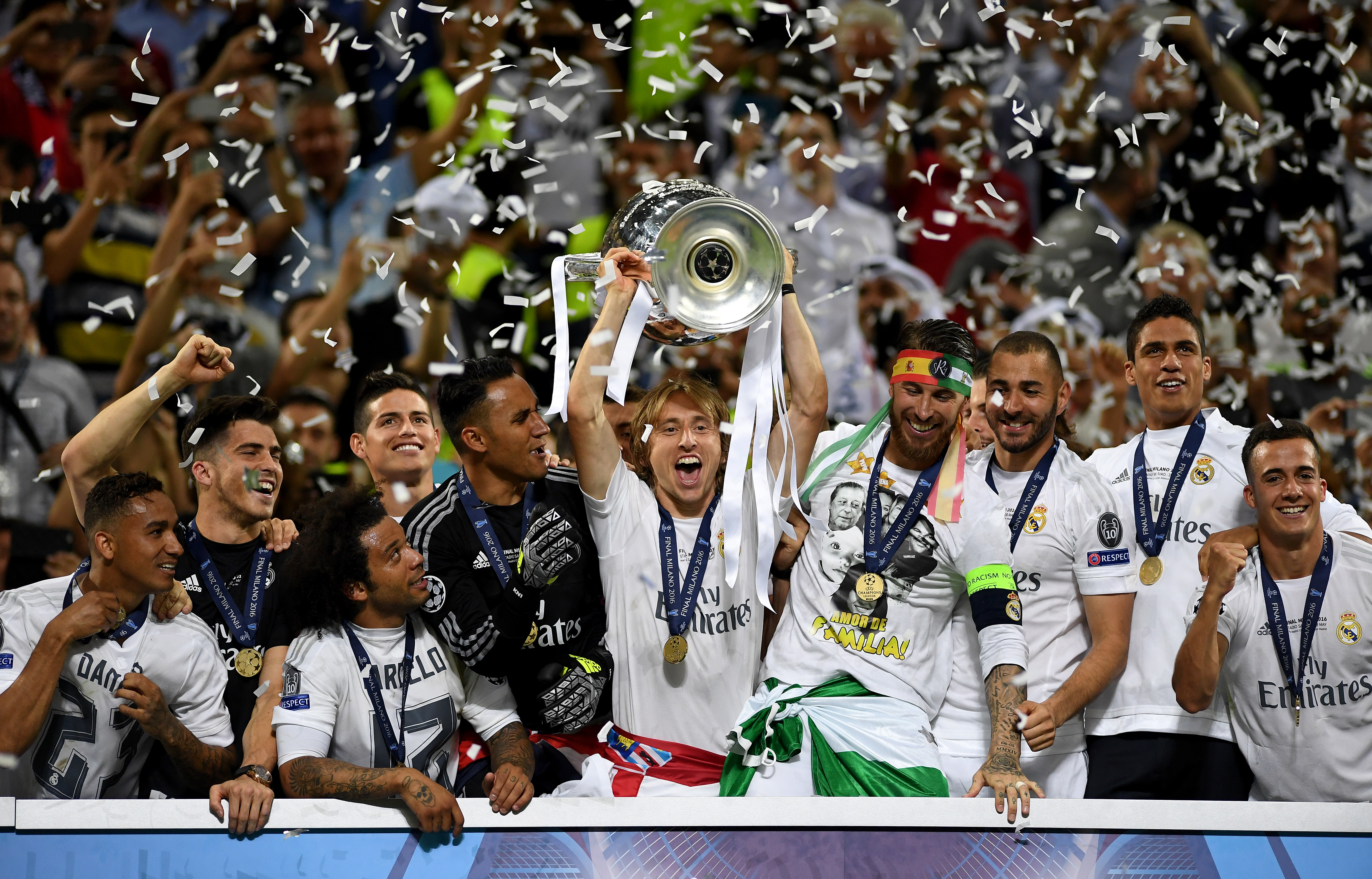MILAN, ITALY - MAY 28: Luka Modric of Real Madrid lifts the Champions League trophy after the UEFA Champions League Final match between Real Madrid and Club Atletico de Madrid at Stadio Giuseppe Meazza on May 28, 2016 in Milan, Italy. (Photo by Laurence Griffiths/Getty Images)