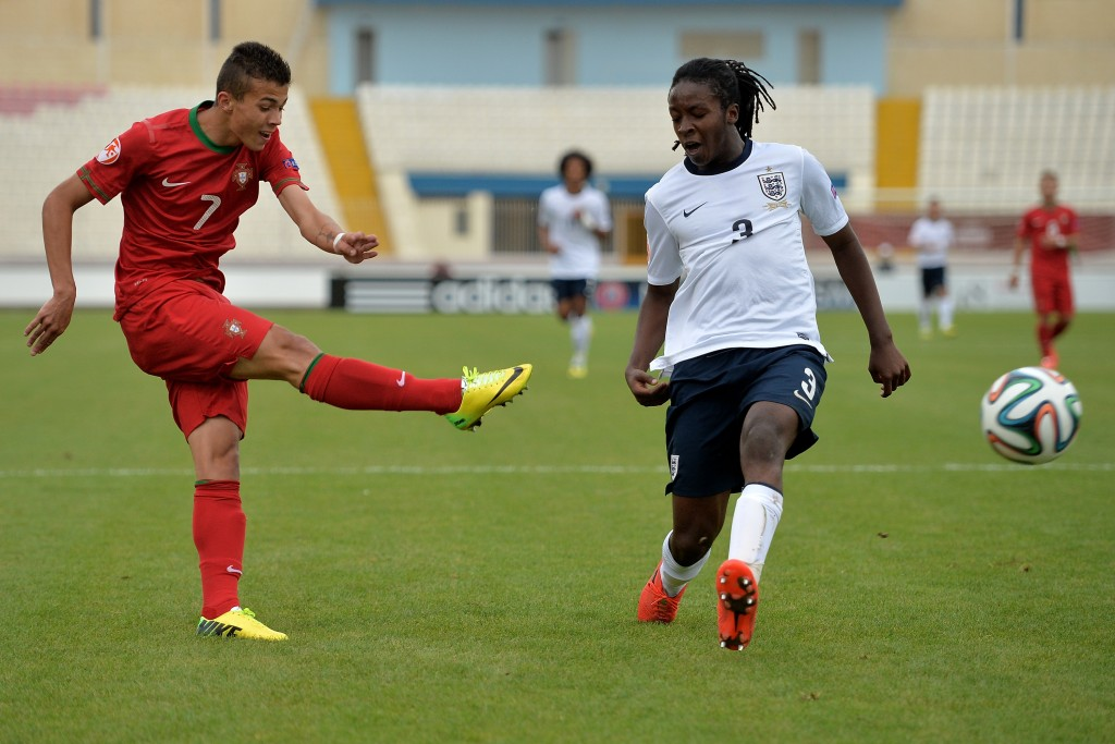 ATTARD, MALTA - MAY 18: (L-R) Diogo Goncalves of Portugal misses a chance at goal as Tafari Moore (R) of England tries to block during the UEFA Under17 European Championship 2014 semi final match between Portugal and England at Ta' Qali National Stadium on May 18, 2014 in Attard, Malta. (Photo by Sascha Steinbach/Bongarts/Getty Images)