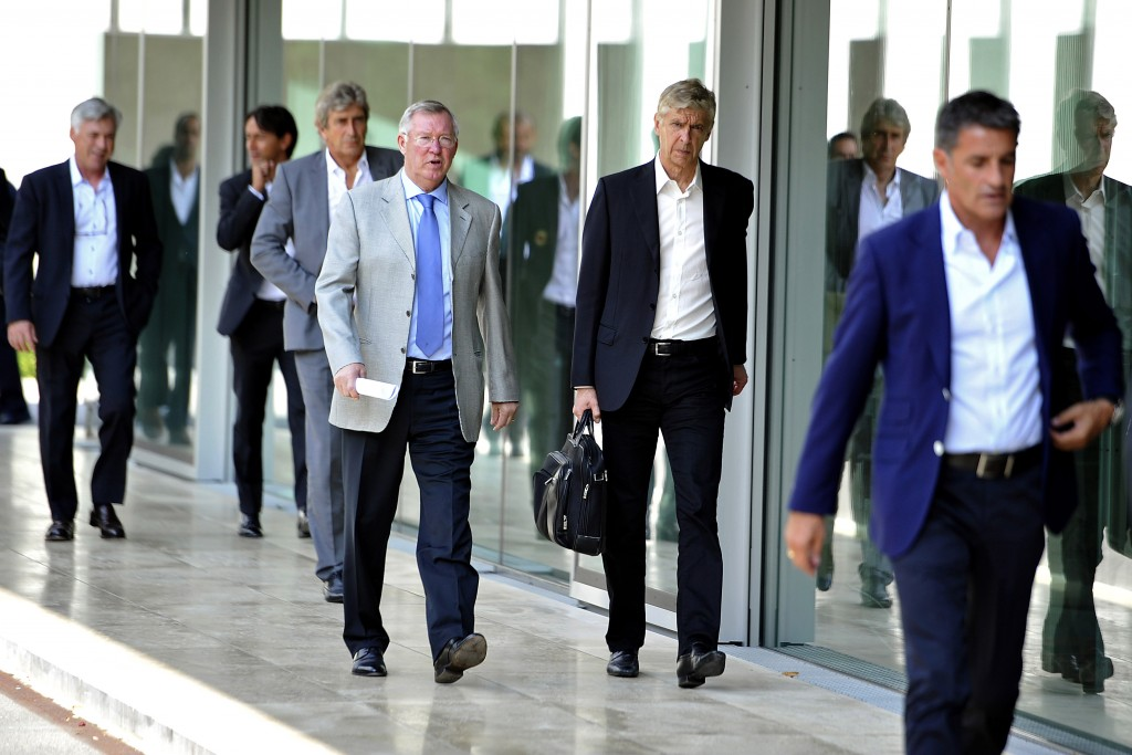 NYON, SWITZERLAND - SEPTEMBER 03: UEFA Elite Club Coaches Forum Chairman Sir Alex Ferguson and Arsenal FC Coach Arsene Wenger arrive for the UEFA Elite Club Coaches Forum at the UEFA headquarters, The House of European Football, on Spetember 3, 2014 in Nyon, Switzerland. (Photo by Harold Cunningham/Getty Images for UEFA)