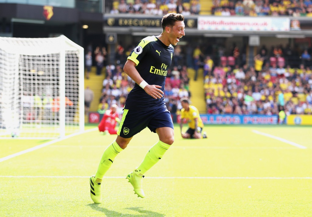 Mesut Ozil of Arsenal celebrates scoring his sides third goal during the Premier League match between Watford and Arsenal at Vicarage Road on August 27, 2016 in Watford, England. (Photo by Christopher Lee/Getty Images)