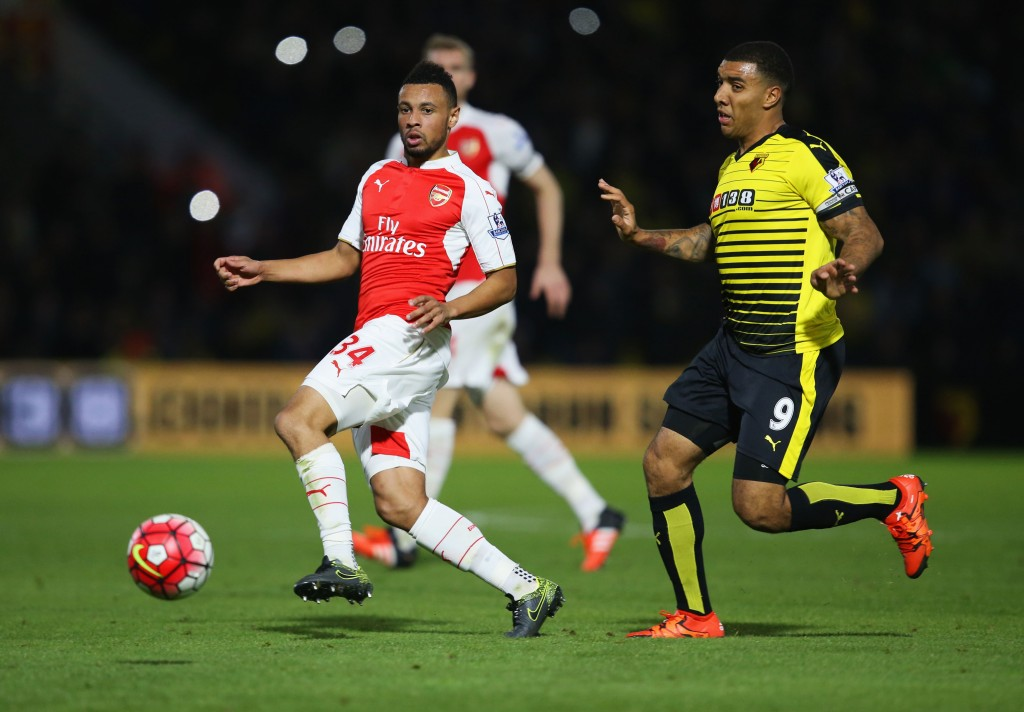 WATFORD, ENGLAND - OCTOBER 17: Francis Coquelin of Arsenal moves the ball away from Troy Deeney of Watford during the Barclays Premier League match between Watford and Arsenal at Vicarage Road on October 17, 2015 in Watford, England. (Photo by Jan Kruger/Getty Images)