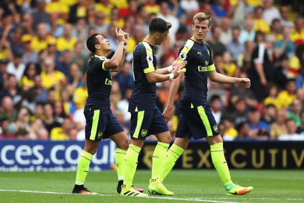 Alexis celebrates after his goal against Watford at Vicarage Road