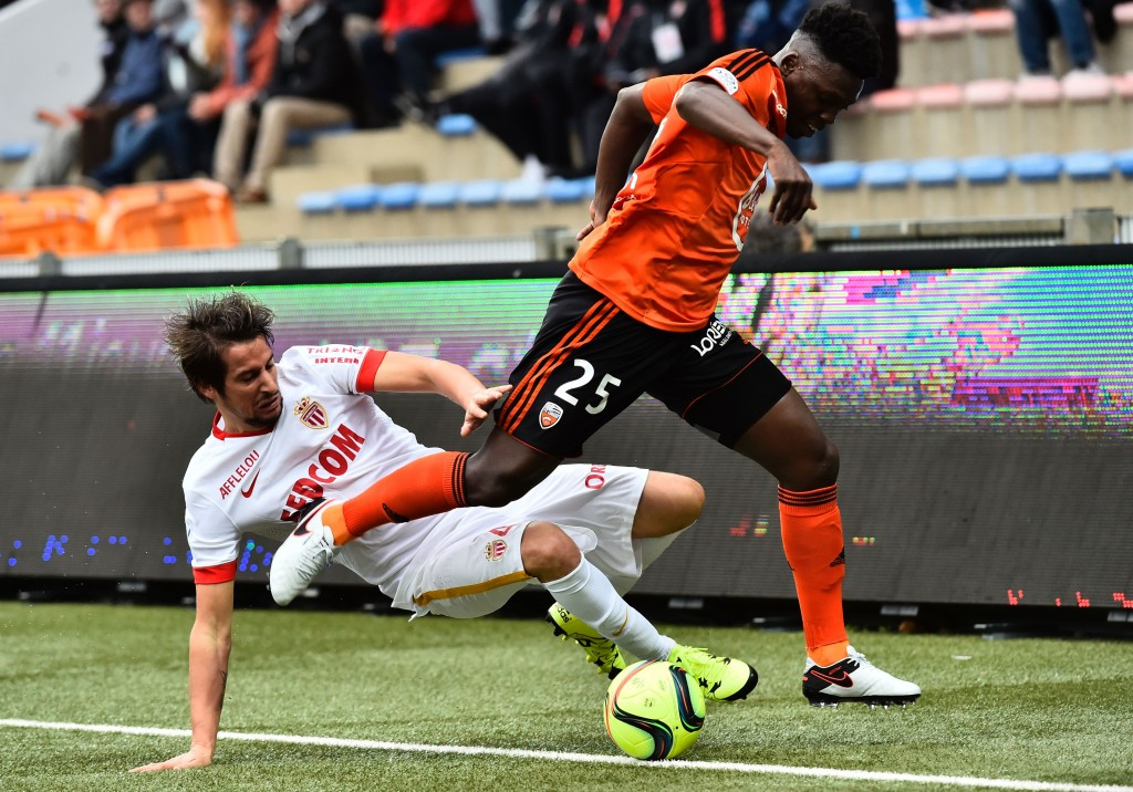 Monaco's Portuguese defender Fabio Coentrao (R) vies with Lorient's French Senegalese defender Lamine Gassama during the French L1 football match Lorient vs Monaco on January 17, 2016 at the Stade du Moustoir stadium in Lorient, western France.     AFP PHOTO / LOIC VENANCE / AFP / LOIC VENANCE        (Photo credit should read LOIC VENANCE/AFP/Getty Images)