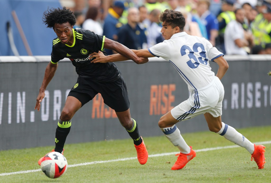 Chelsea forward Juan Cuadrado (L) kicks the ball past Real Madrid defender Achraf Hakimi (R) during an International Champions Cup soccer match in Ann Arbor, Michigan on July 30, 2016. / AFP / Jay LaPrete (Photo credit should read JAY LAPRETE/AFP/Getty Images)