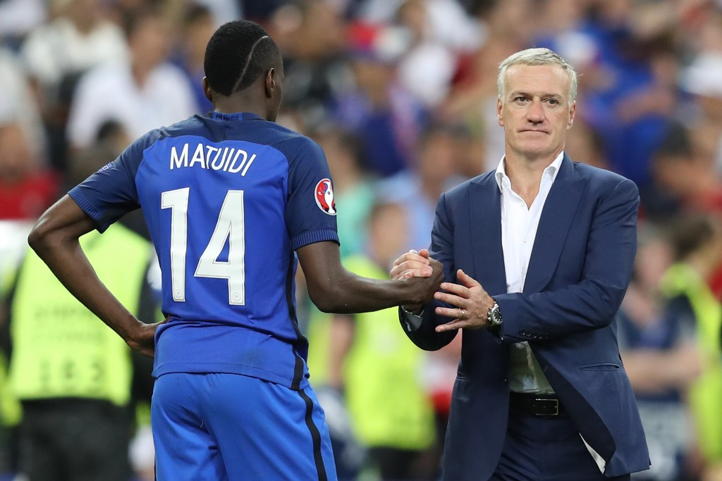 France's midfielder Blaise Matuidi (L) and France's coach Didier Deschamps react after France lost the Euro 2016 final football match against Portugal at the Stade de France in Saint-Denis, north of Paris, on July 10, 2016. / AFP / Valery HACHE        (Photo credit should read VALERY HACHE/AFP/Getty Images)