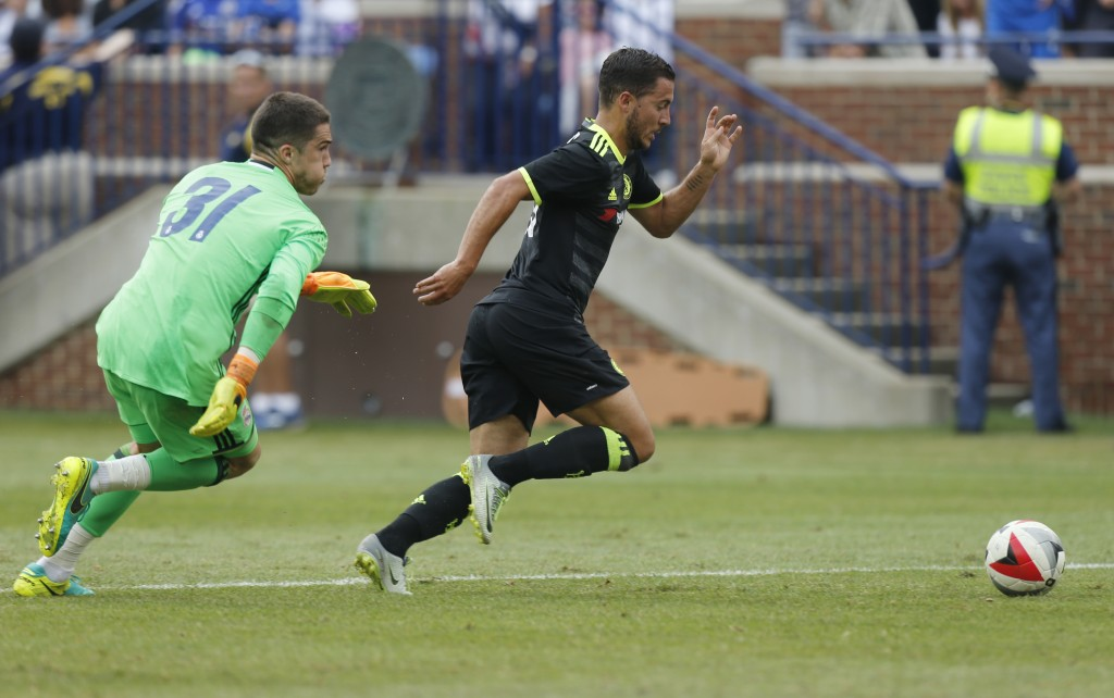 Chelsea midfielder Eden Hazard (R) dribbles past Real Madrid goalkeeper Ruben Yanez (L) to score a goal during an International Champions Cup soccer match in Ann Arbor, Michigan on July 30, 2016. / AFP / Jay LaPrete (Photo credit should read JAY LAPRETE/AFP/Getty Images)